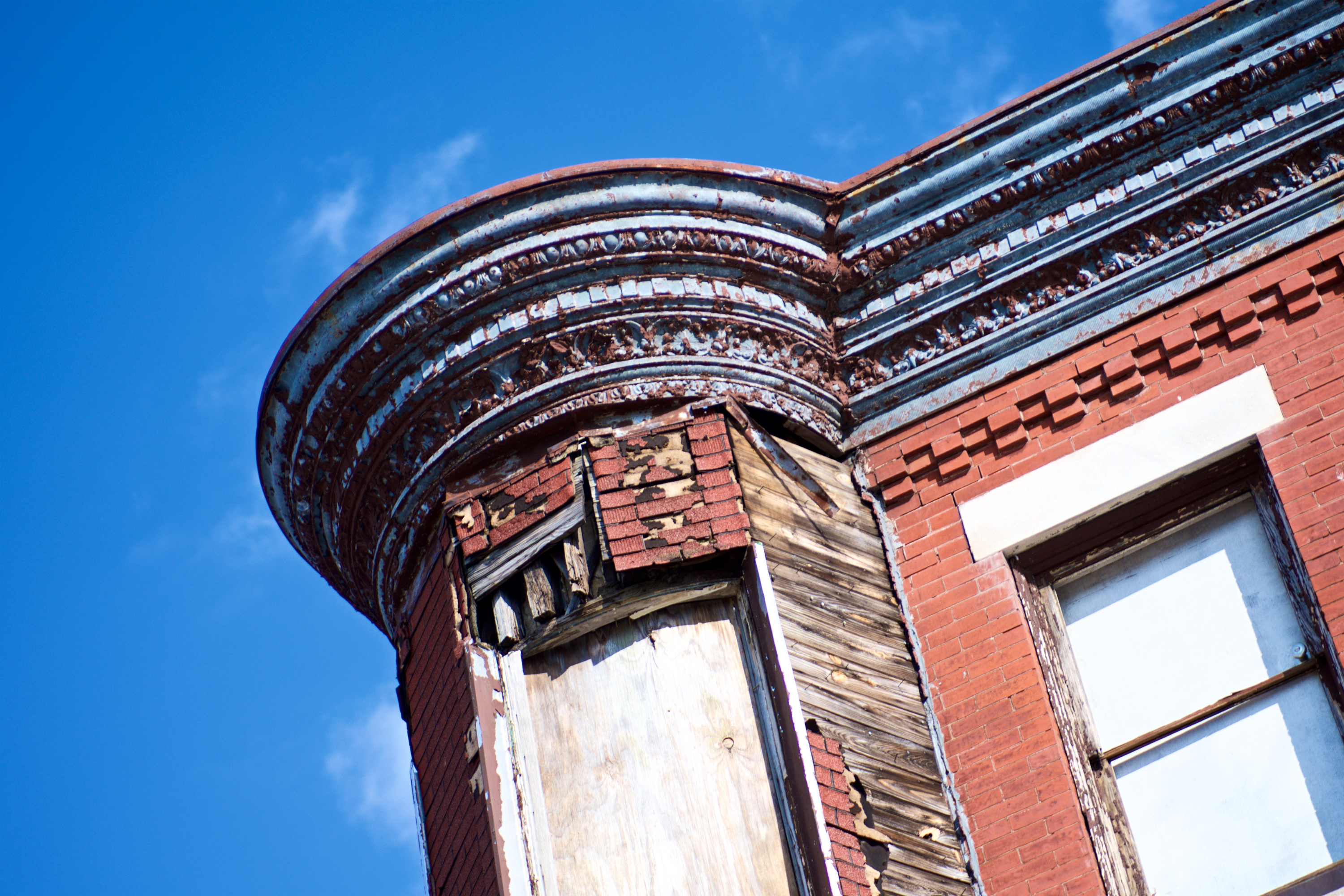 Architectural details on a historic residence in need of repair. (Bas Slabber/WHYY)