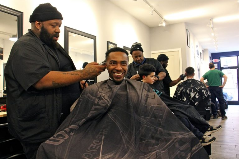 """Barbering is not just cutting hair,"" South Street Barbers' Mike Jordan says. ""You got counseling, advising, you get friendships. Credit: Emma Lee/WHYY"