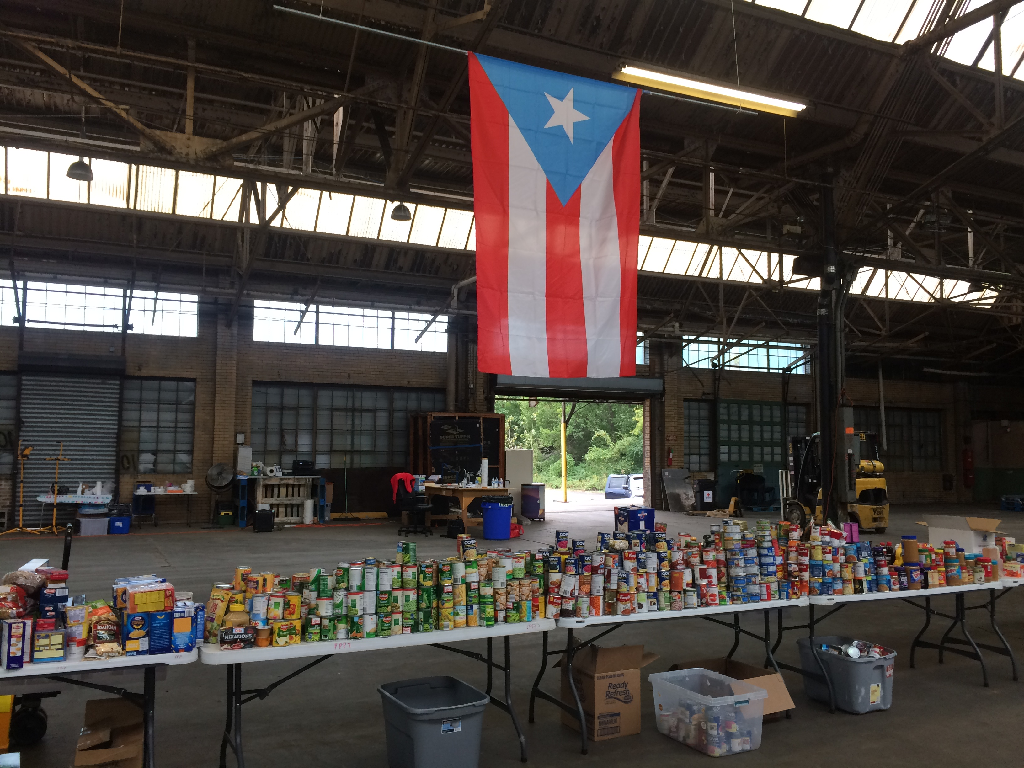 Food donations are sorted by volunteers at the Unidos Pa' PR warehouse at 956 East Erie Ave.
