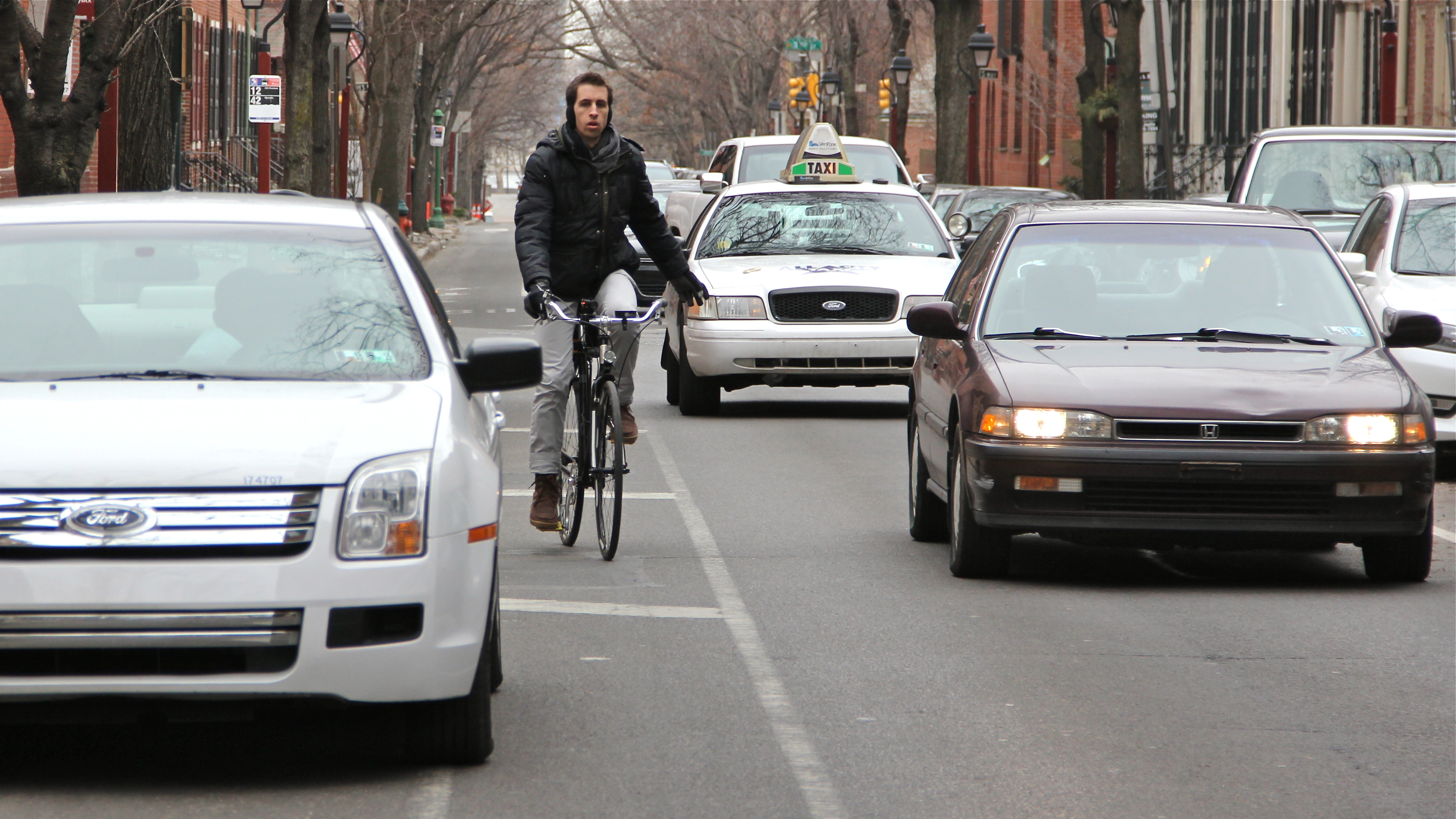 Cars and bikes compete on many Philadelphia streets despite bike lanes.