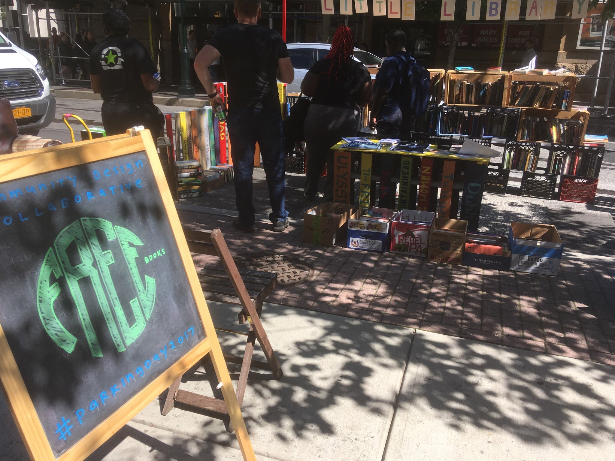 Community Design Collaborative promoted Little Libraries at 12th and Arch, giving away free books
