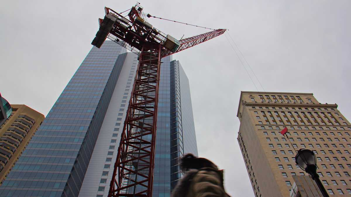 A large crane looms over Chestnut Street.