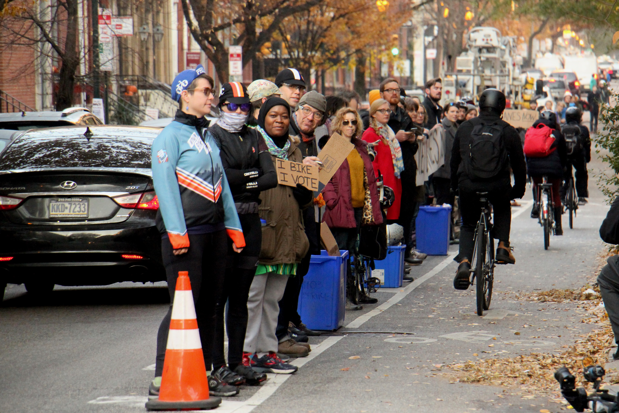 Cyclists form a human-protected bike lane along Spruce Street on Nov. 29, 2017, one day after Emily Fredricks was struck and killed on the street.