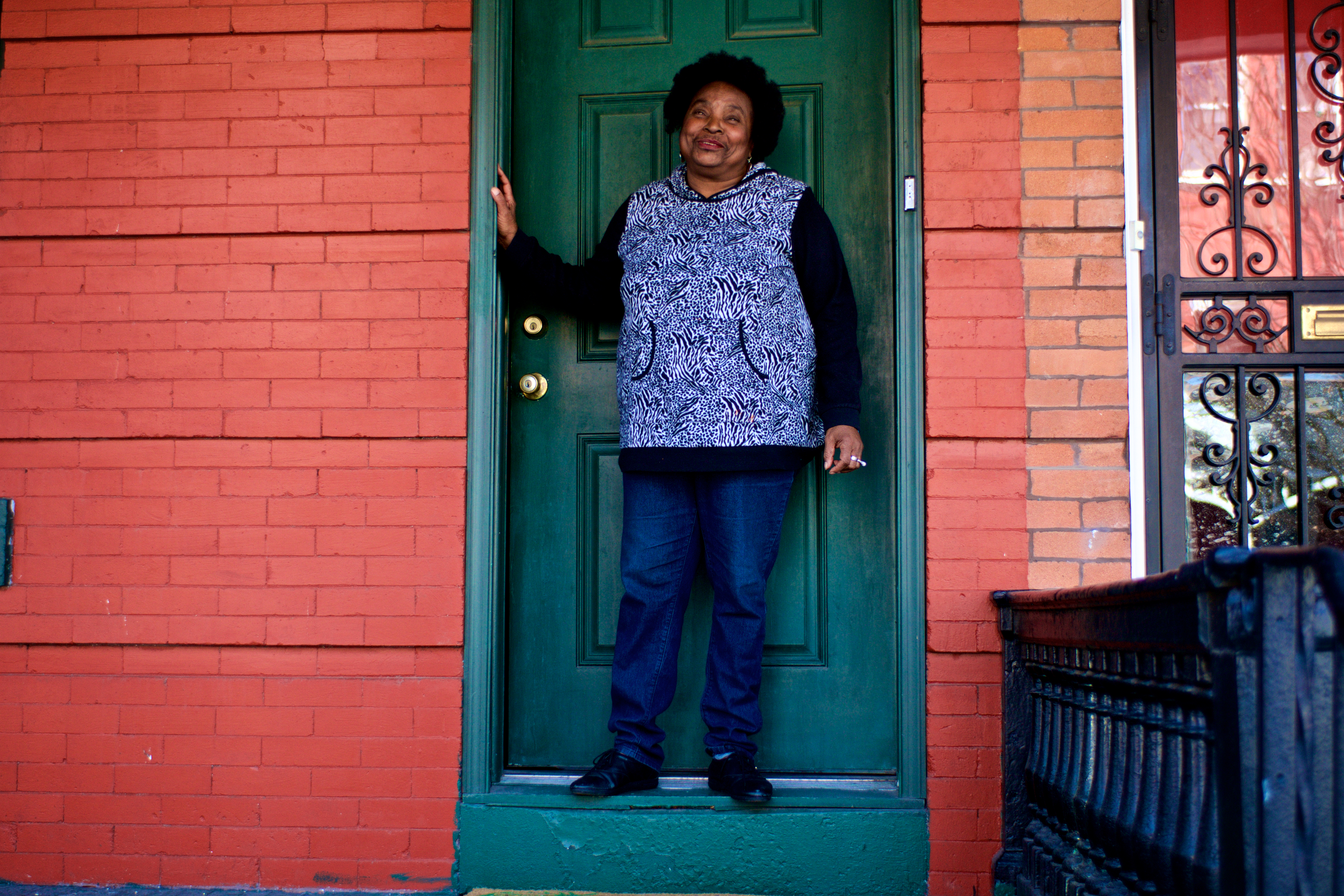 Denise Clark in front of her home. (Bas Slabbers/WHYY)
