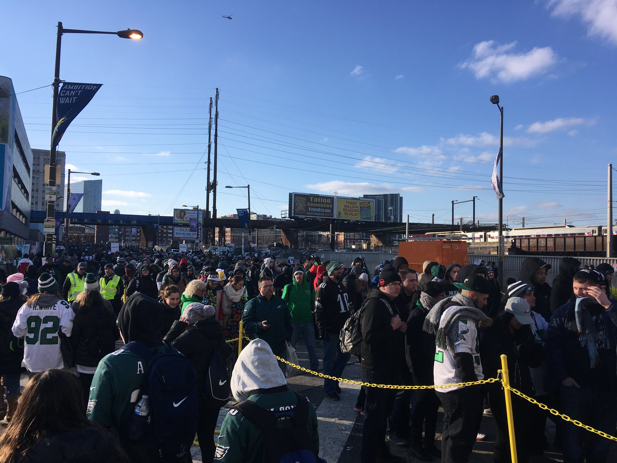Eagles paradegoers wait in line to get into 30th Street Station. Credit: Jim Saksa/WHYY