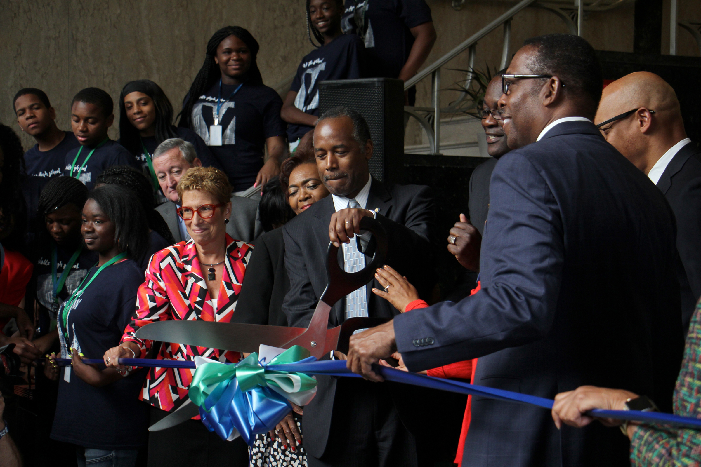 Flanked by Philadelphia officials, HUD Sec. Carson cuts ribbon at opening of Vaux Big Picture High School in Sharswood