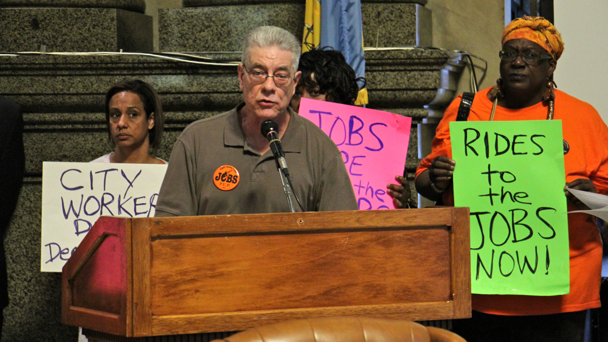 John Dodds, of the Philadelphia Unemployment Project, calls for reverse commute assistance for city residents during a press conference at City Hall. (Emma Lee/WHYY)