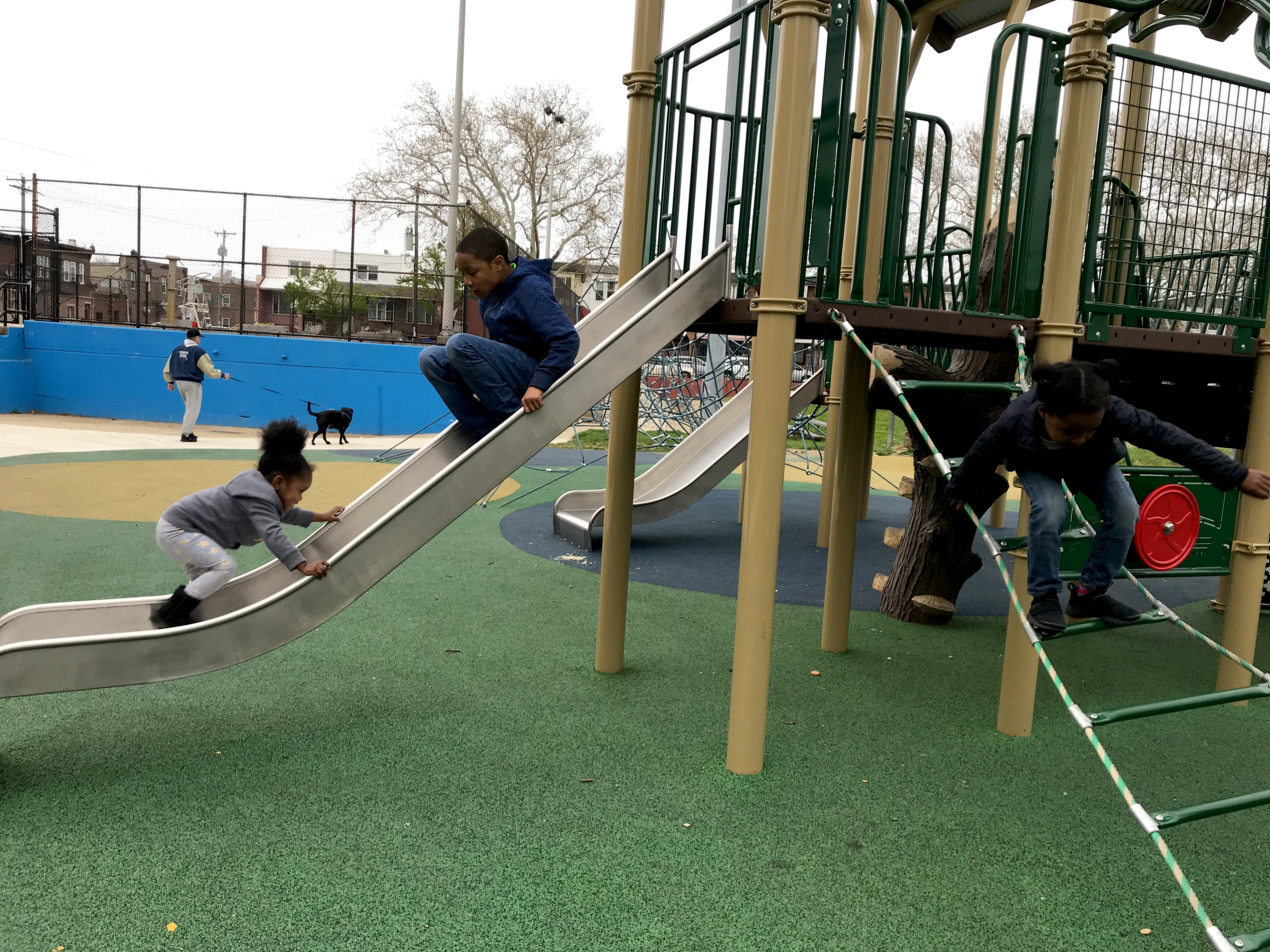 Lamaj Laws and Lauren Solomon play at an inclusive playground at Murphy Rec Center. (Ariella Cohen/ WHYY)