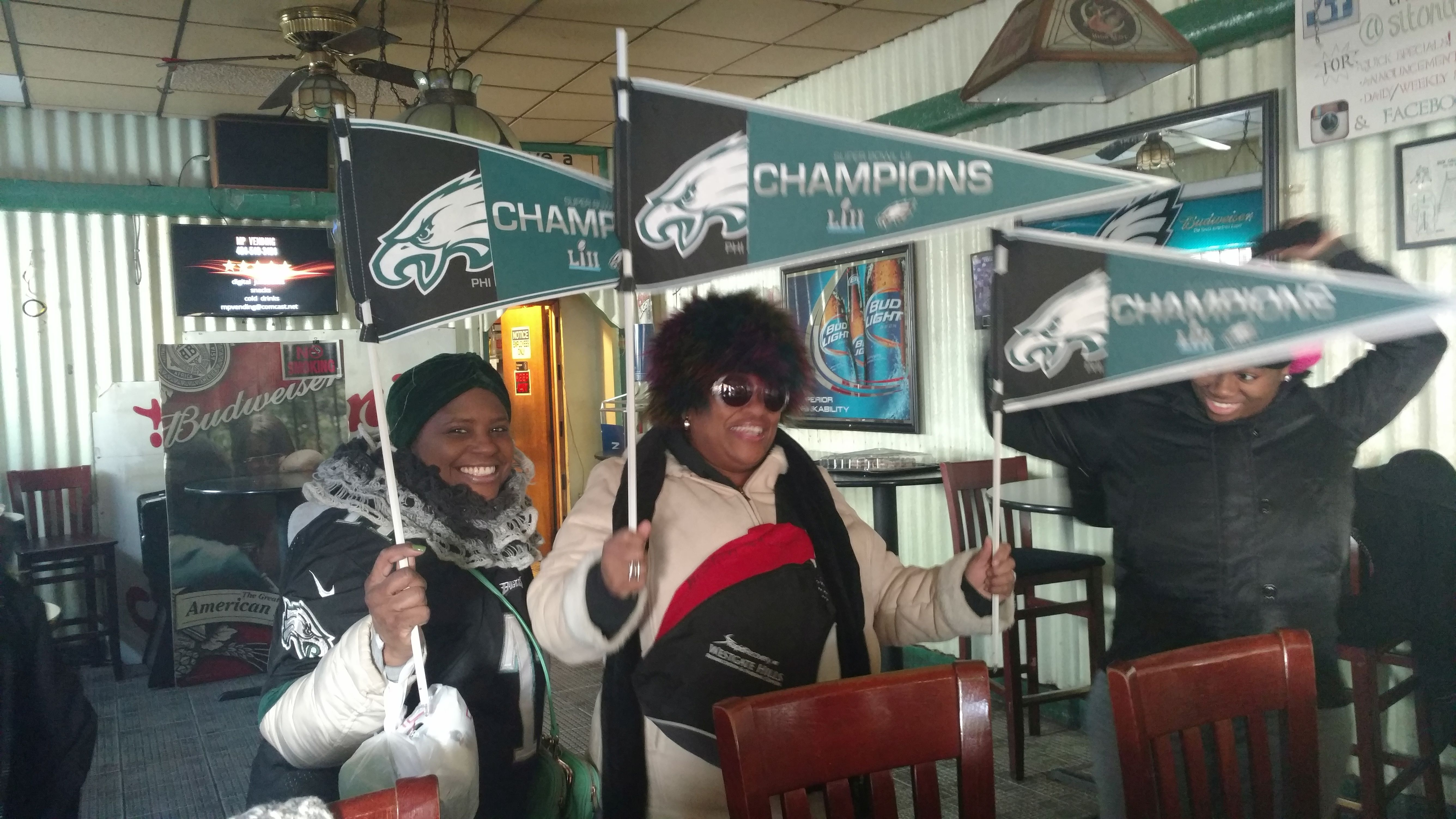 Laverne Daves and Earlene Stith celebrate in Sit On It bar