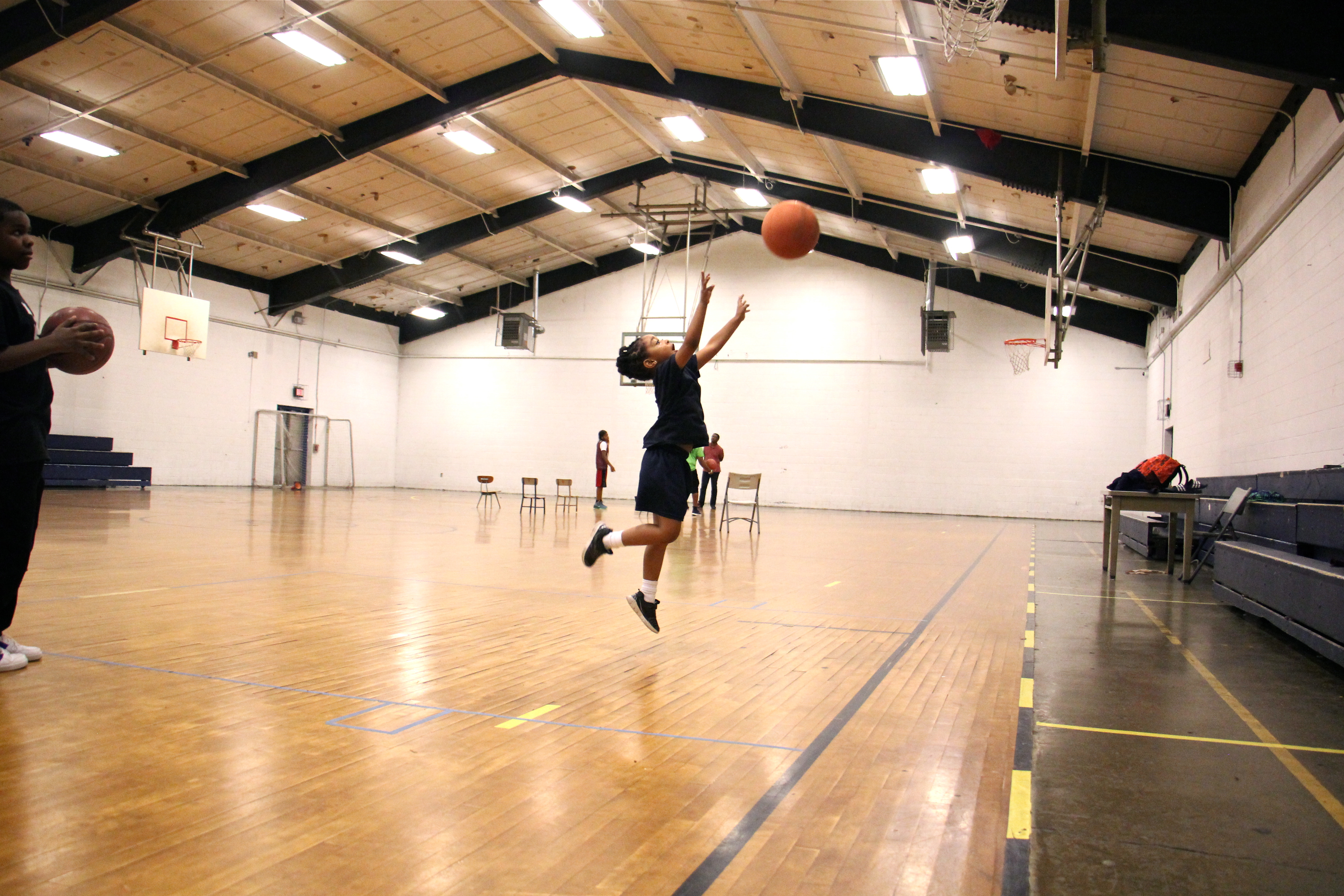 Leilani Jackson, 5, takes plays in the gym during an afterschool program at Olney Rec Center. (Emma Lee/WHYY)