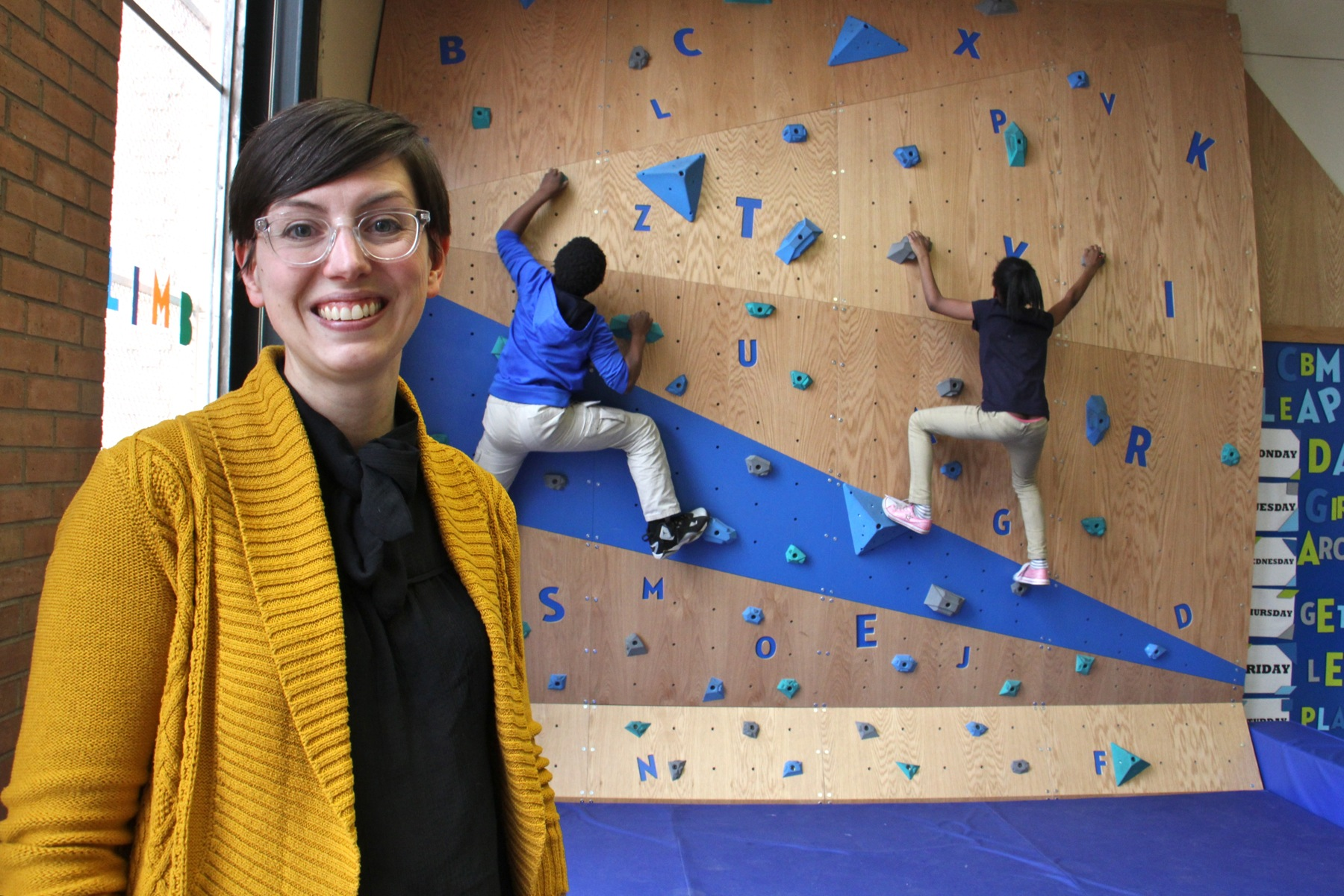 Meghan Talarowski of Studio Ludo designed the climbing wall at the Cecil B. Moore library with the idea that children need risky play. (Emma Lee/WHYY)