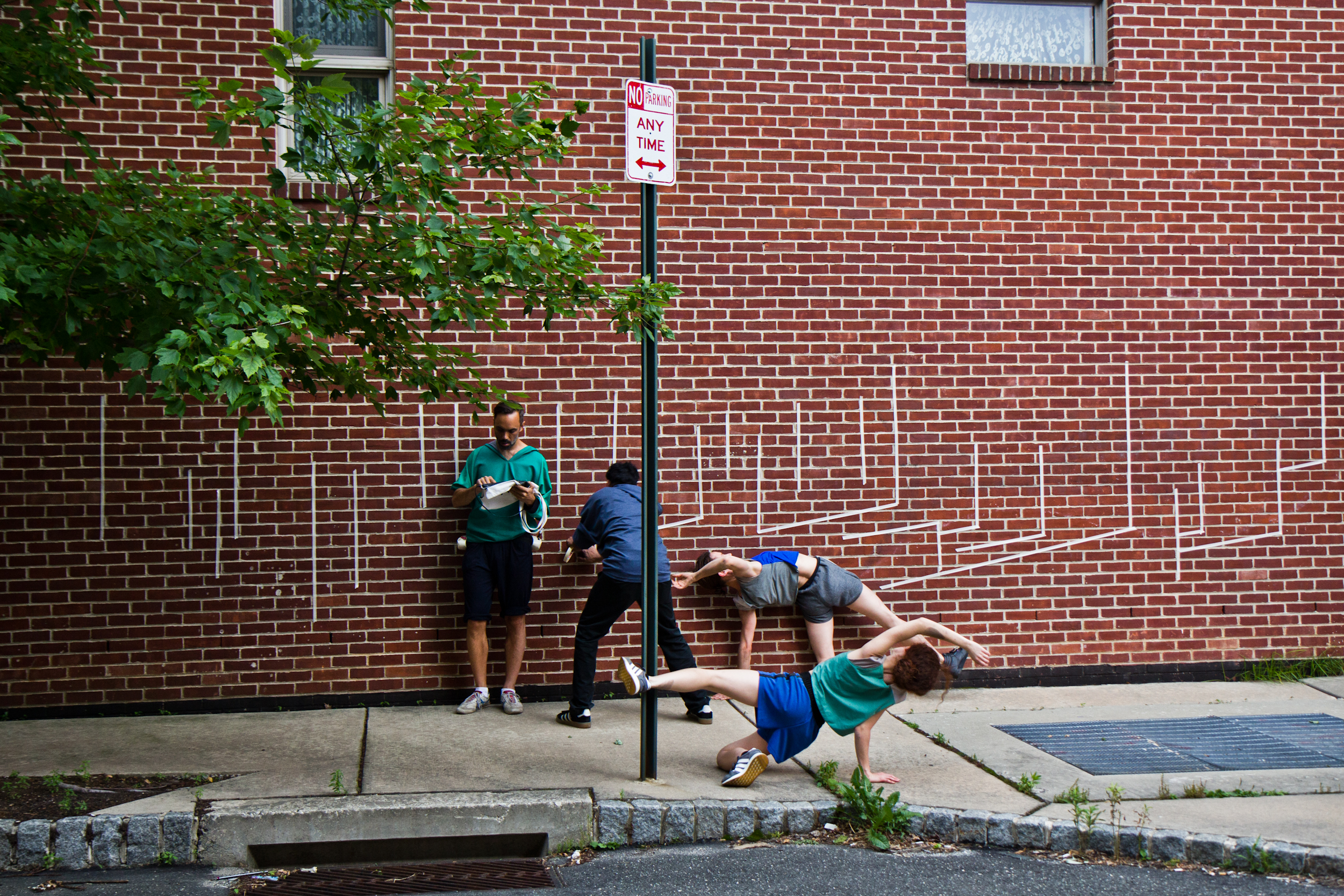 Members of the Swiss theater troupe Asphalt Piloten take to a Philadelphia street Tuesday evening for a performance of Tape Riot, part of the Philadelphia International Festival of the Arts.