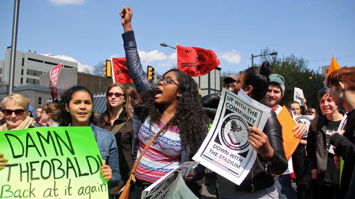 Neighbors and students in an April 2016 protest march against a proposed new football stadium. (Emma Lee/WHYY)