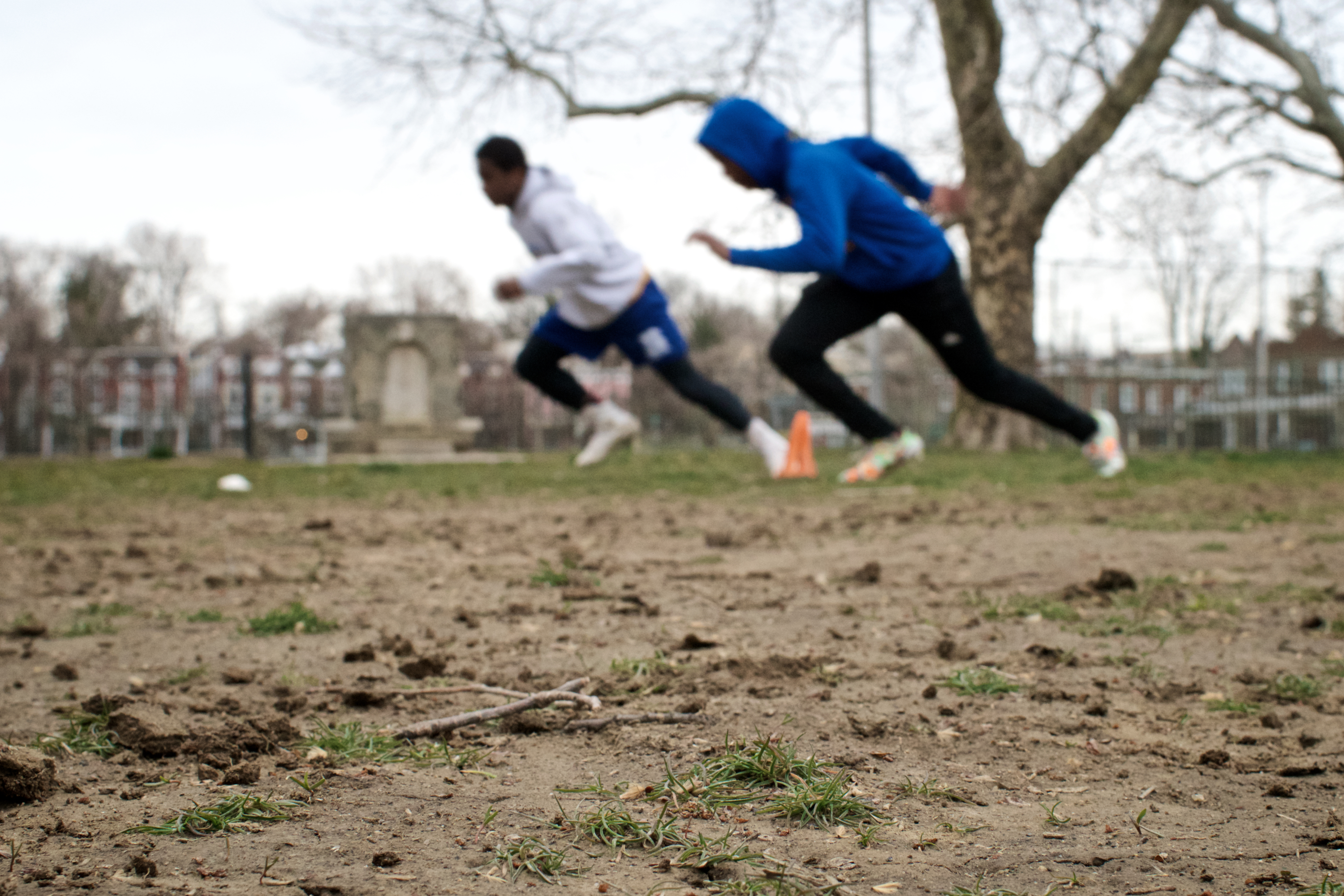 NW Raiders practice on the muddy city-owned football field behind Lonnie Young Rec. Center. (Bastiaan Slabbers for WHYY)