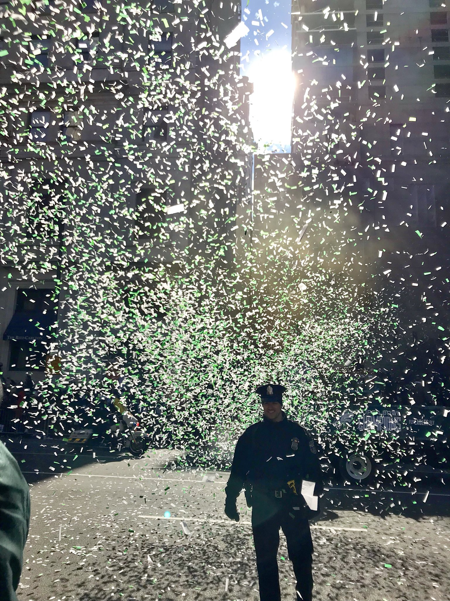 Philadelphia Police officer shrouded in Eagles glitter. Credit: Kim Jordan