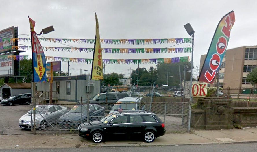 Portable feather signs hanging at an auto lot in Northeast Philadelphia | Google Street View, 2014
