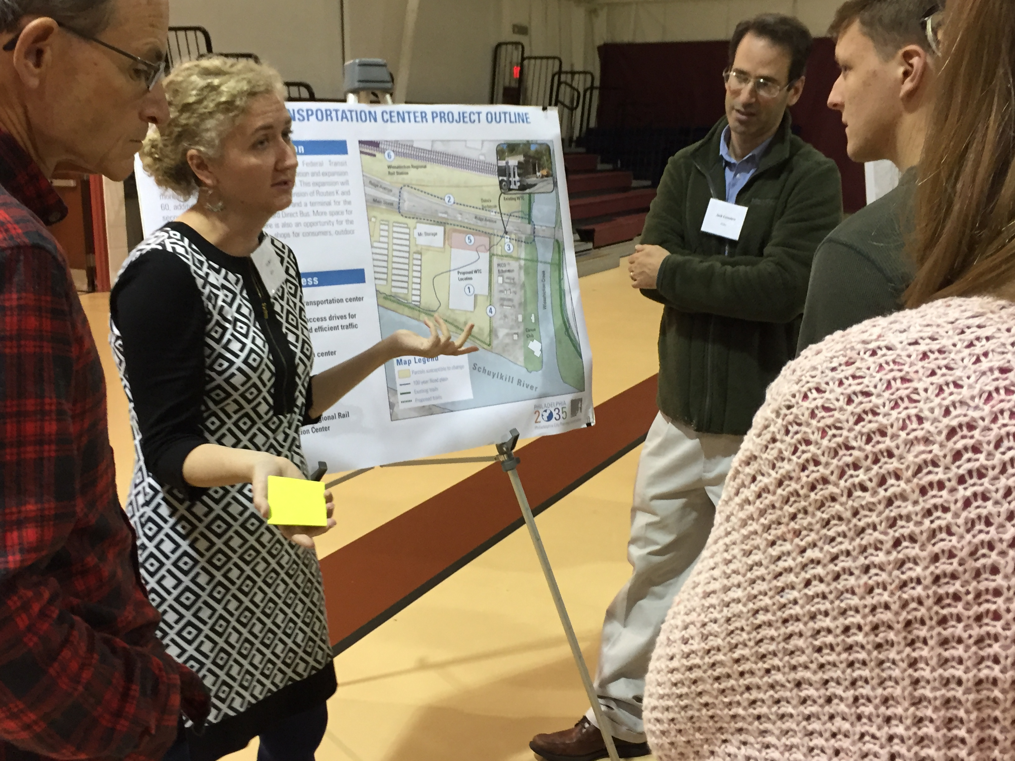 SEPTA Planner Jennifer Barr talks with local residents