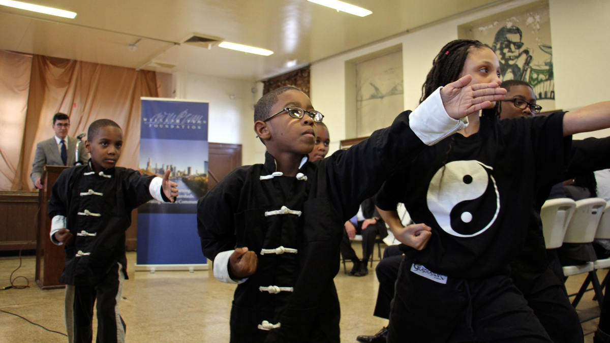 Students at Cecil B. Moore Rec Center during the announcement of a $100 million grant from the William Penn Foundation to improve civic spaces in Philadelphia, November 2016 (Emma Lee/WHYY)
