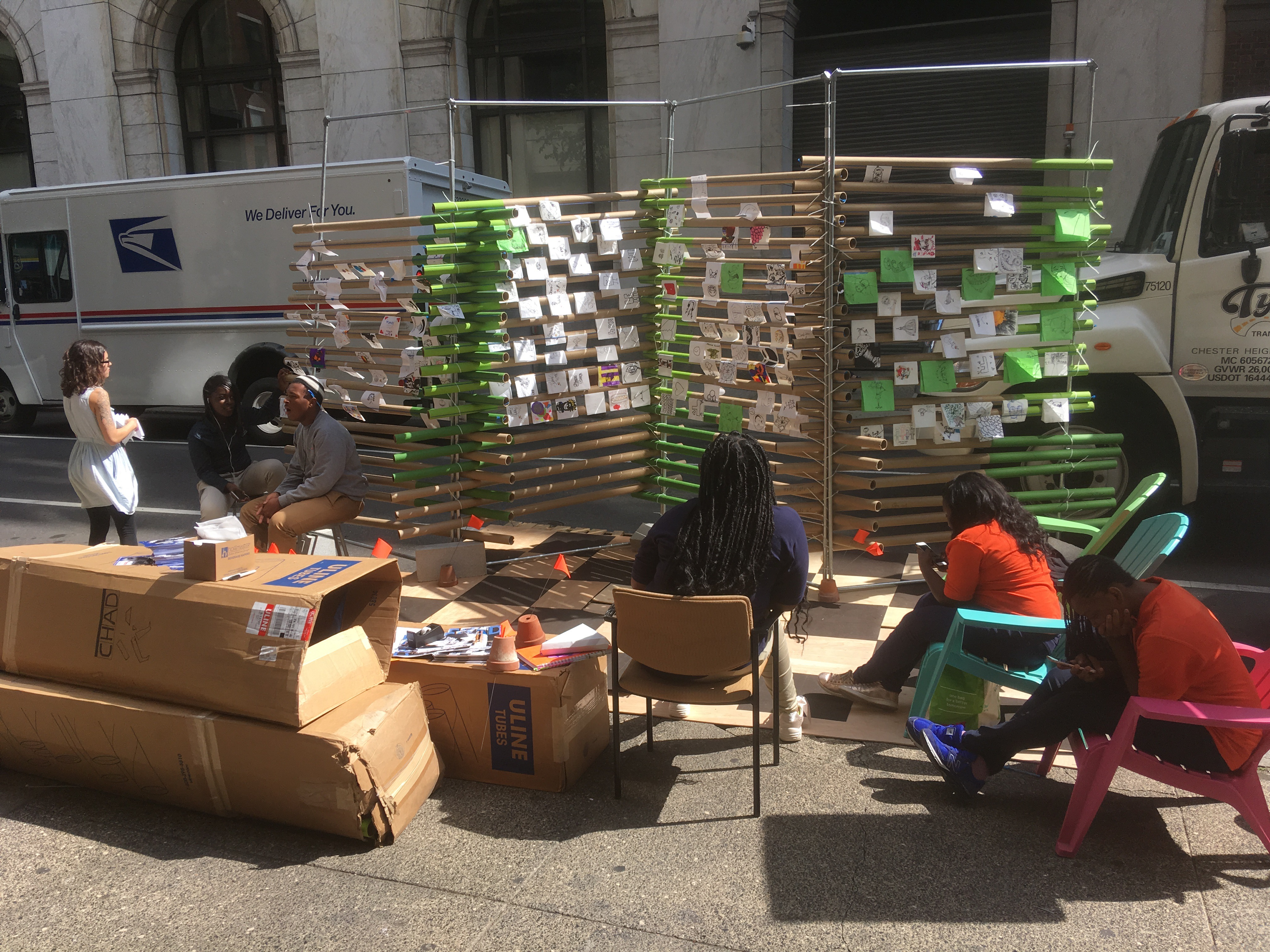 Students from Charter High school for Architecture and Design offer a participatory pop-up art gallery, asking pedestrians to offer their drawings