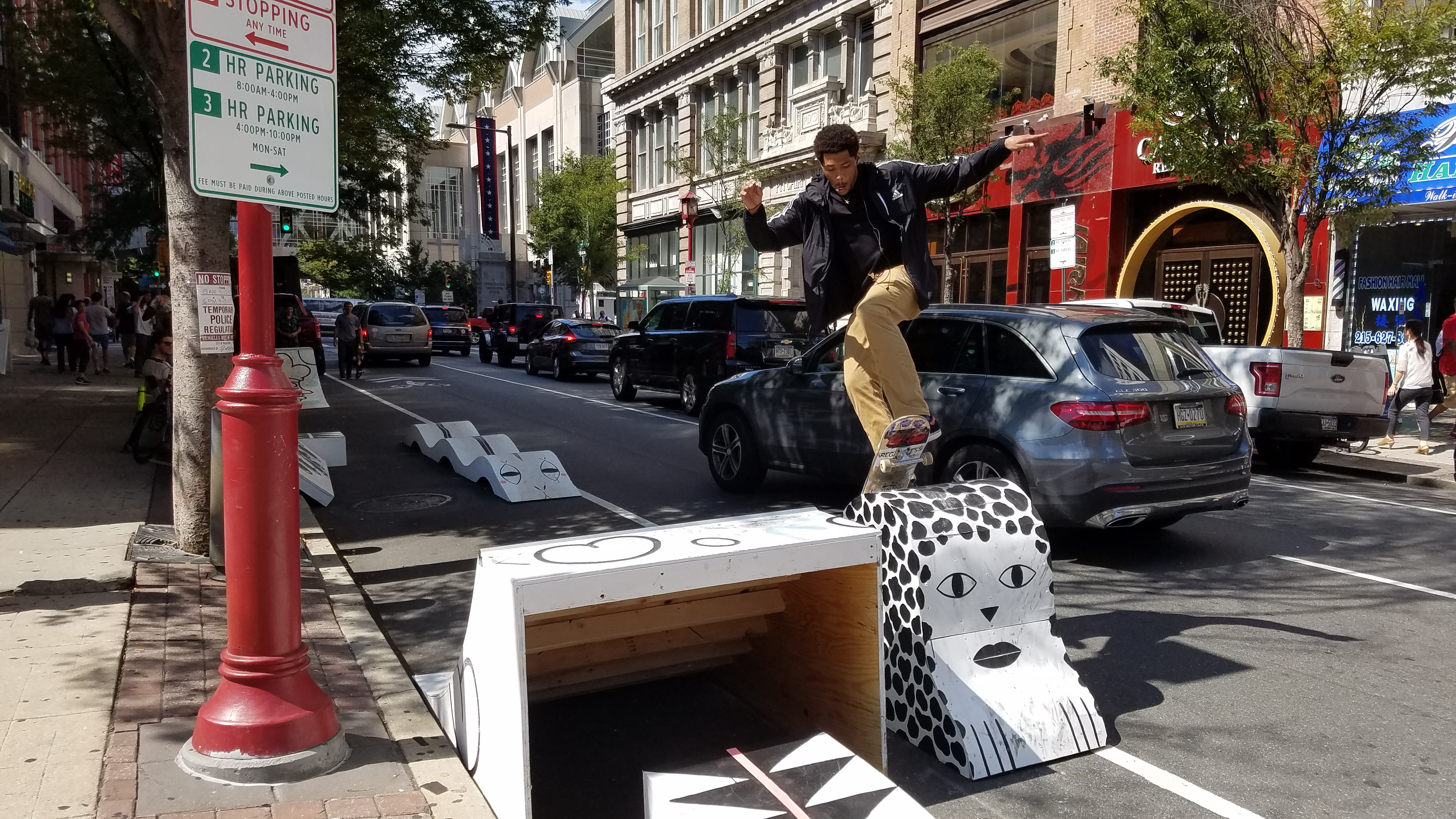 Unknown skater enjoys pop-up skate parklet at Park(ing) Day 2017 on Arch Street near 11th. Designed by James Booney of Space 1026.