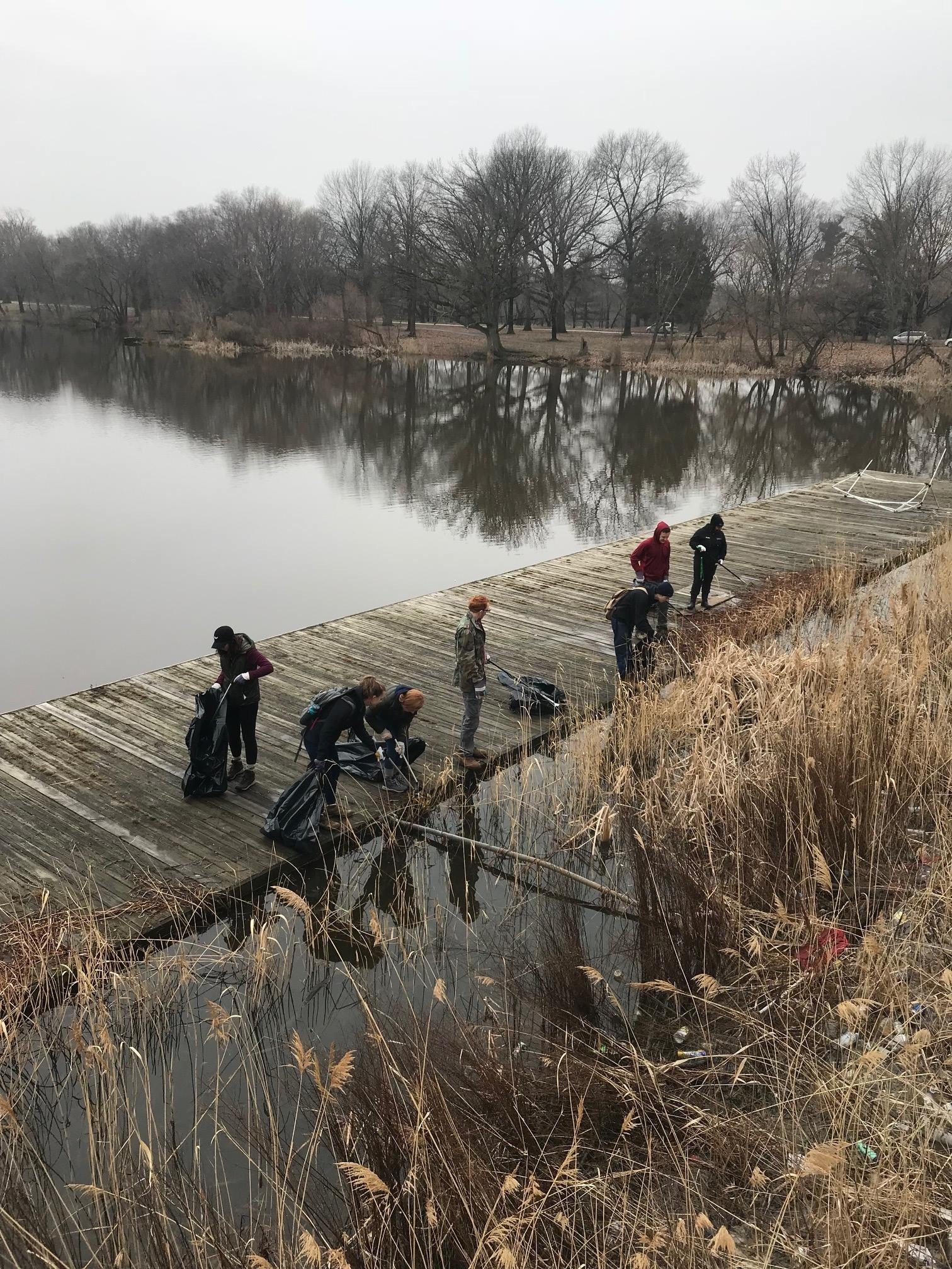 Volunteers clean up one of the lakes at FDR Park on a cold February day. (Photo credit: Friends of FDR Park/Facebook)
