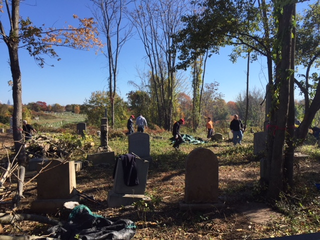 Volunteers clear overgrowth at Mount Moriah.