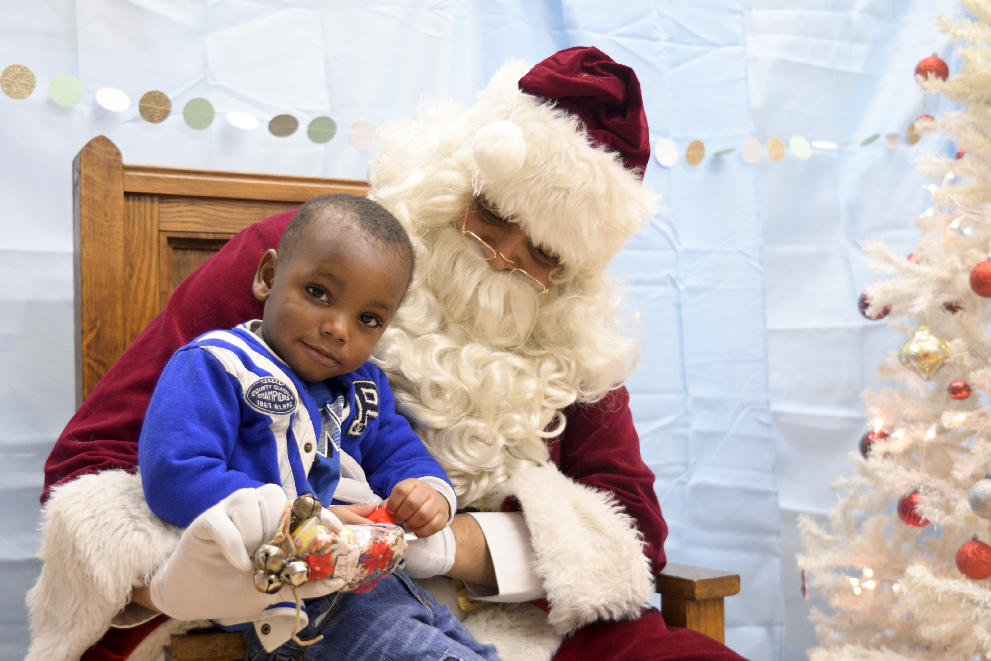 A young boy gets his picture with Santa and the Annual Winter Festival in Olney. Bas Slabbers/WHYY.