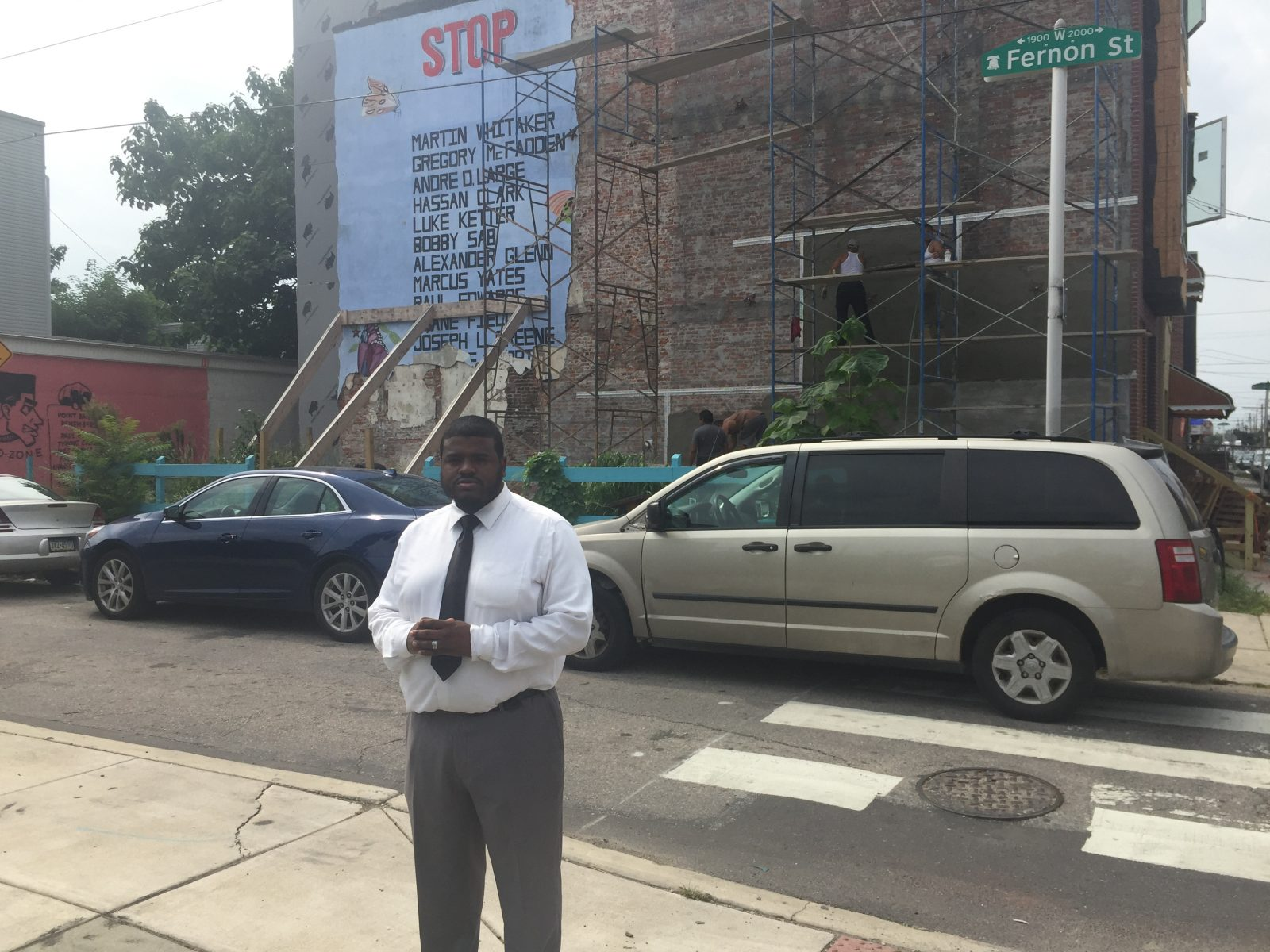 Darryl Roberts walks past the mural often. His cousin, Marcus Yates, was killed in the crossfire of a gunfight 30 years ago. | Annette John-Hall/WHYY News