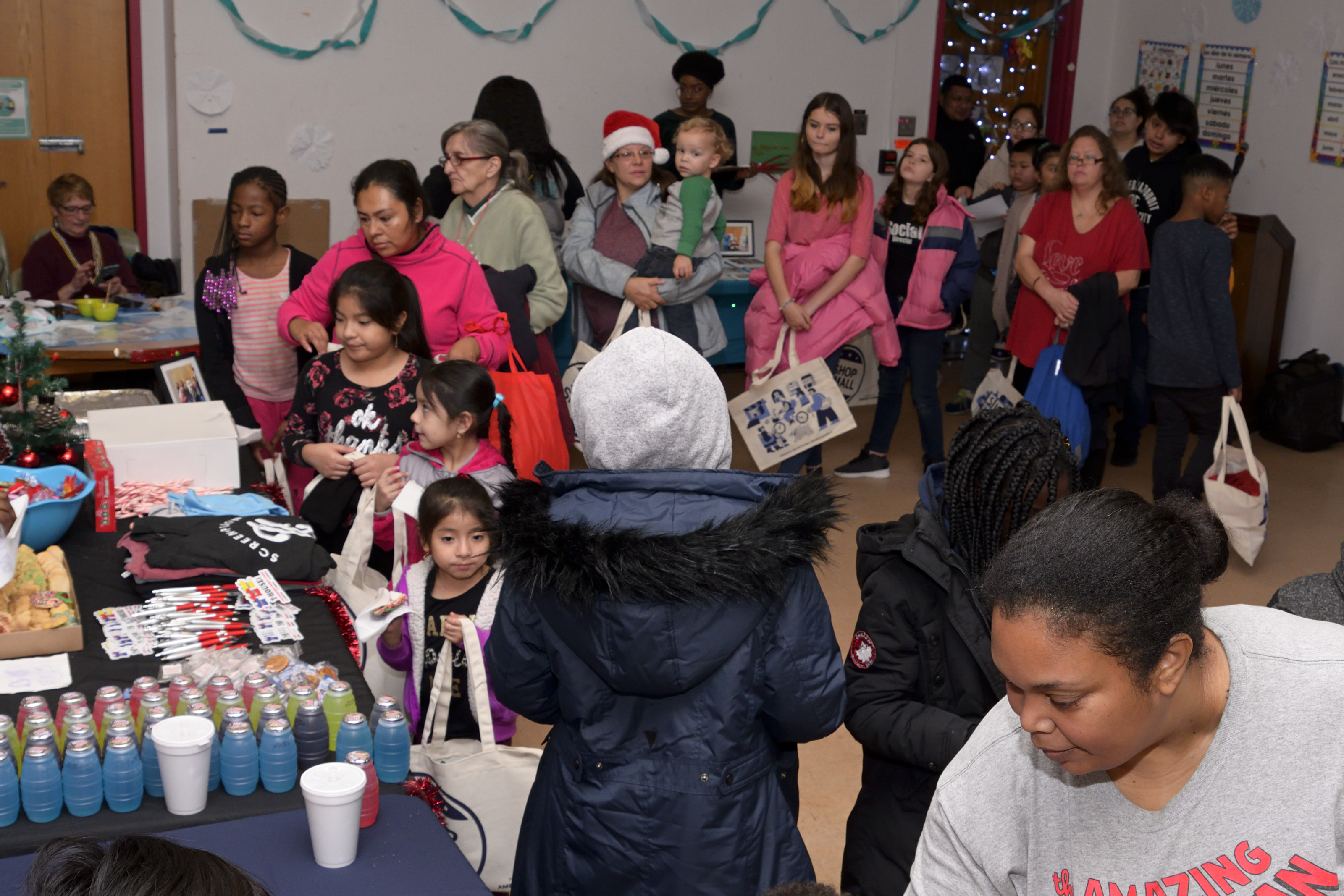 Families line up for toys, snacks, and games at the Annual Winter Festival in Olney. Bas Slabbers/WHYY