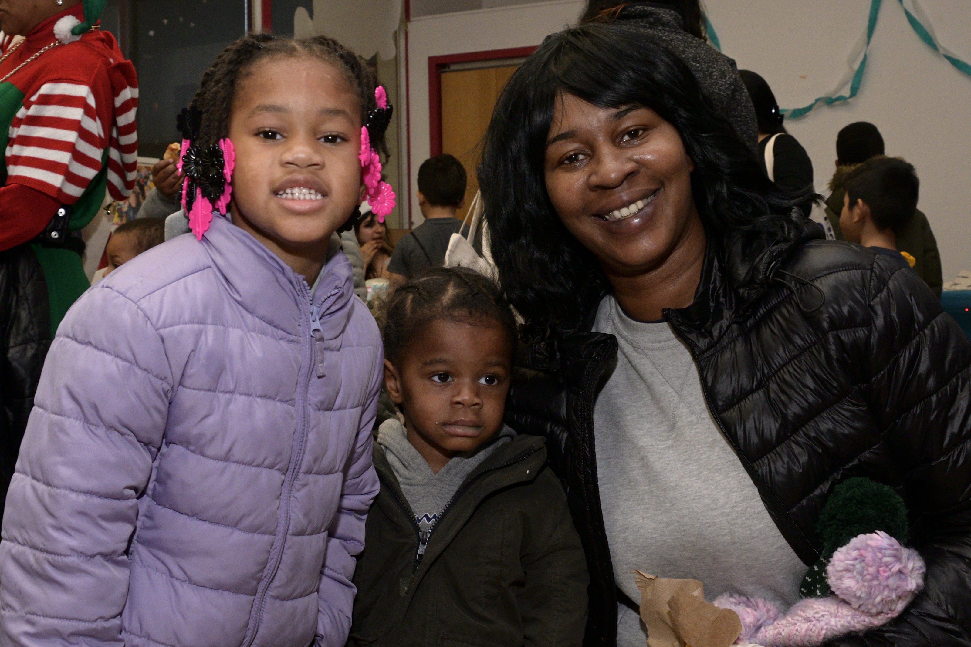 Iris Caple with her family at the Annual Winter Festival in Olney. Bas Slabbers/WHYY.