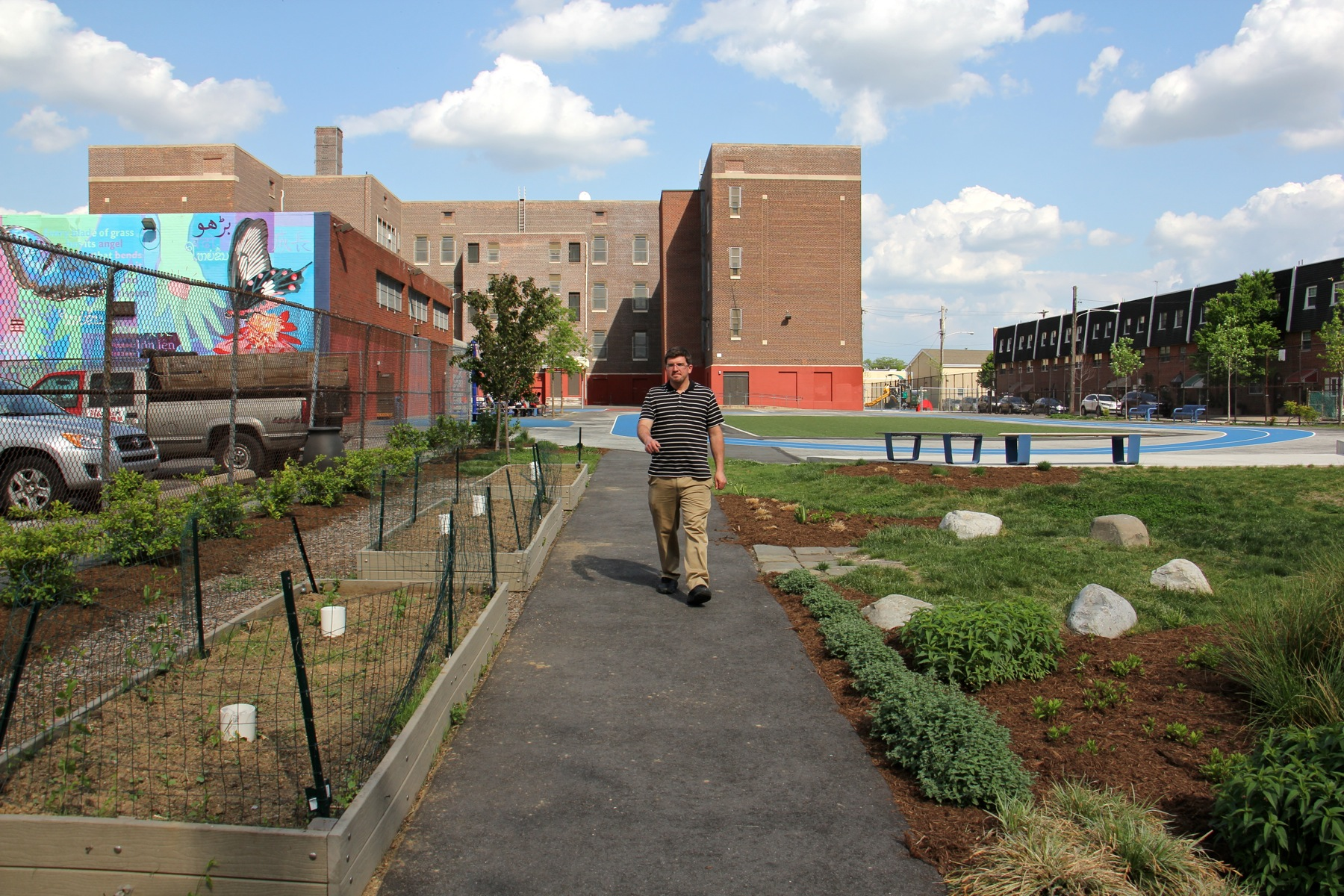 Raised garden beds are used by Taggart School's diverse community to raise food, says Dean of Students David Hensel. (Emma Lee/WHYY)