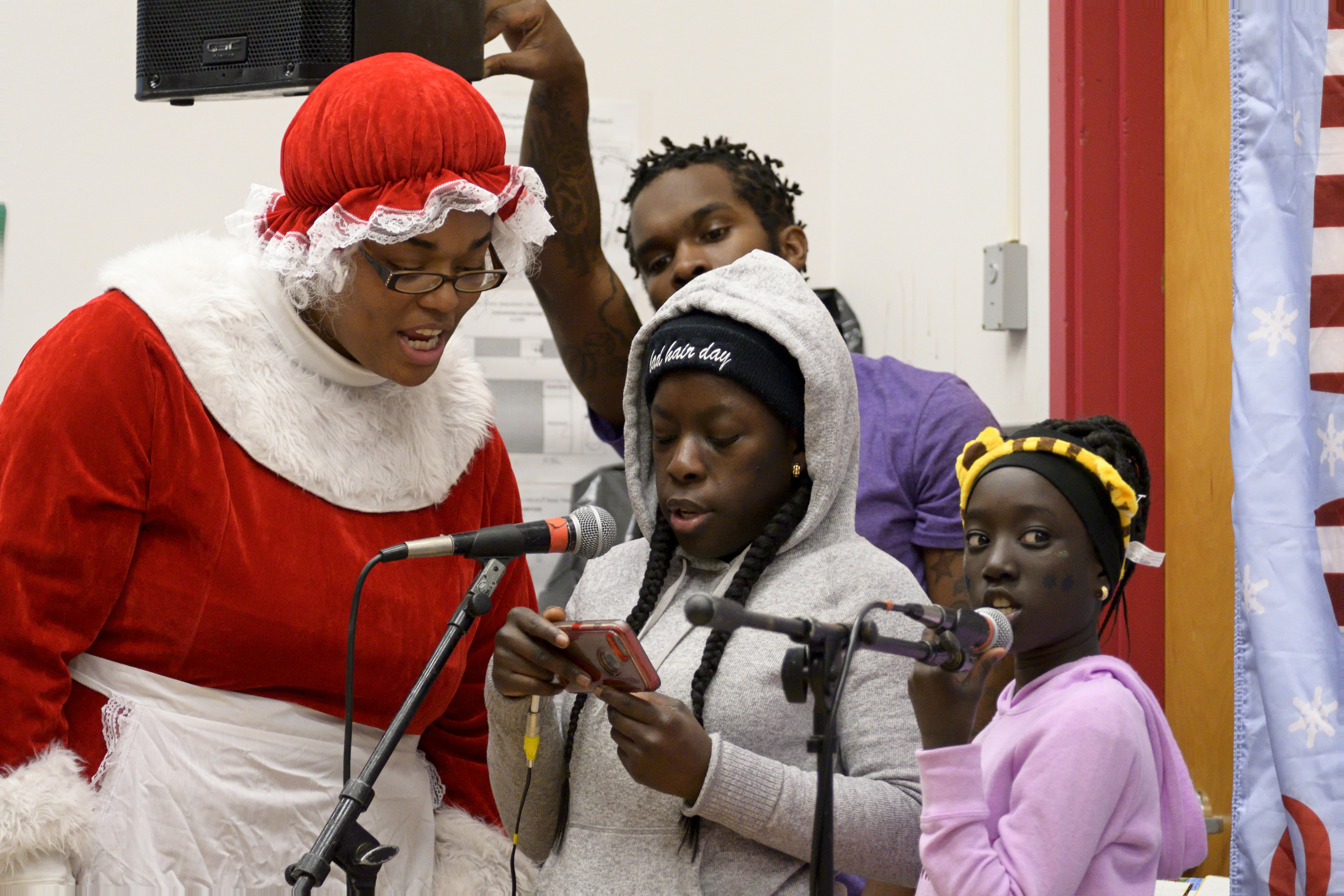 Singing along with Mrs. Clause at the Annual Winter Festival in Olney. Bas Slabbers/WHYY.