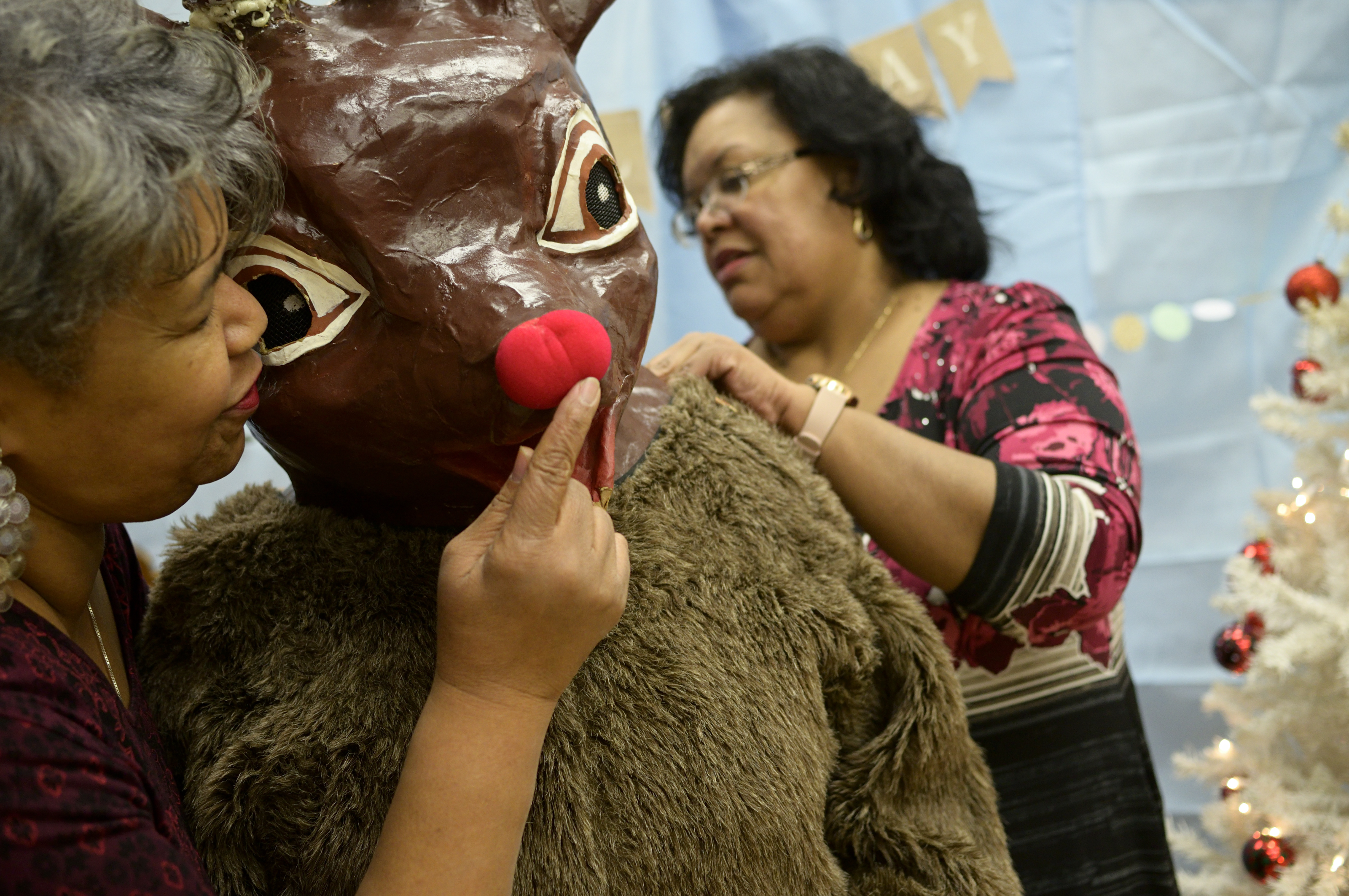 Staff members from Councilwoman Parker's office help prep Rudolph for the Annual Winter Festival in Olney. Bas Slabbers/WHYY.