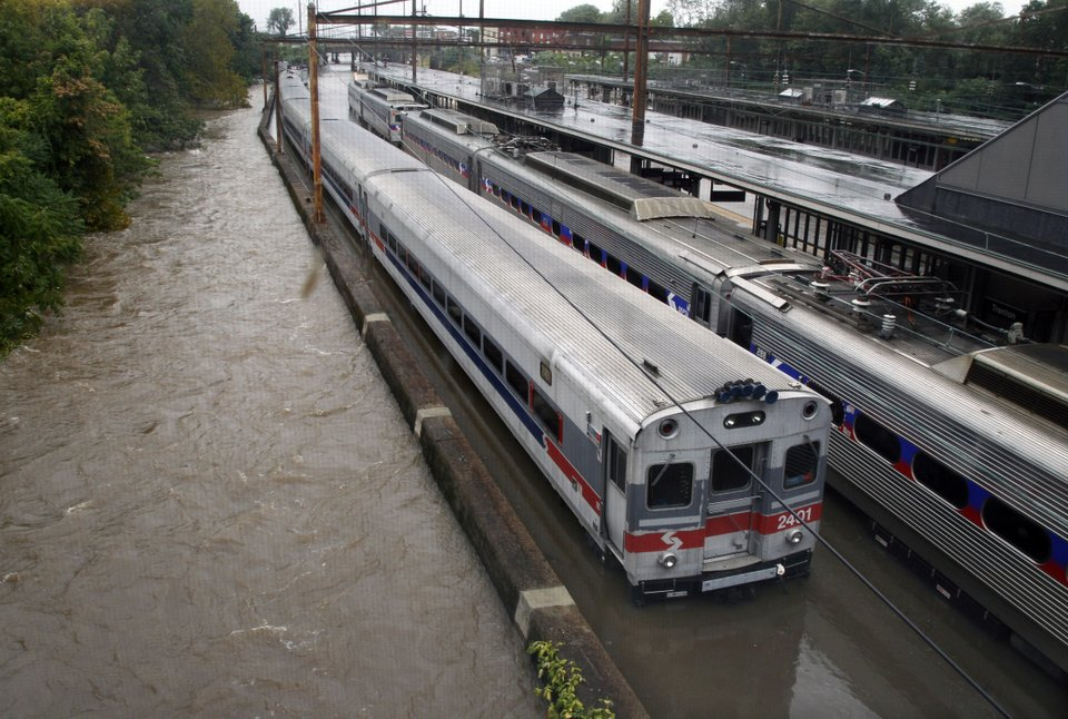 Associated Press Trenton flood puts chokehold on busy Amtrak line
