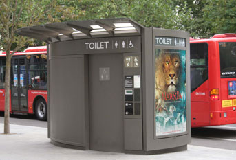 A JCDecaux public restroom, with advertising