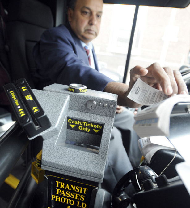Toronto bus driver tries out a new farebox, equipped with a Metro Pass reader. TORONTO STAR