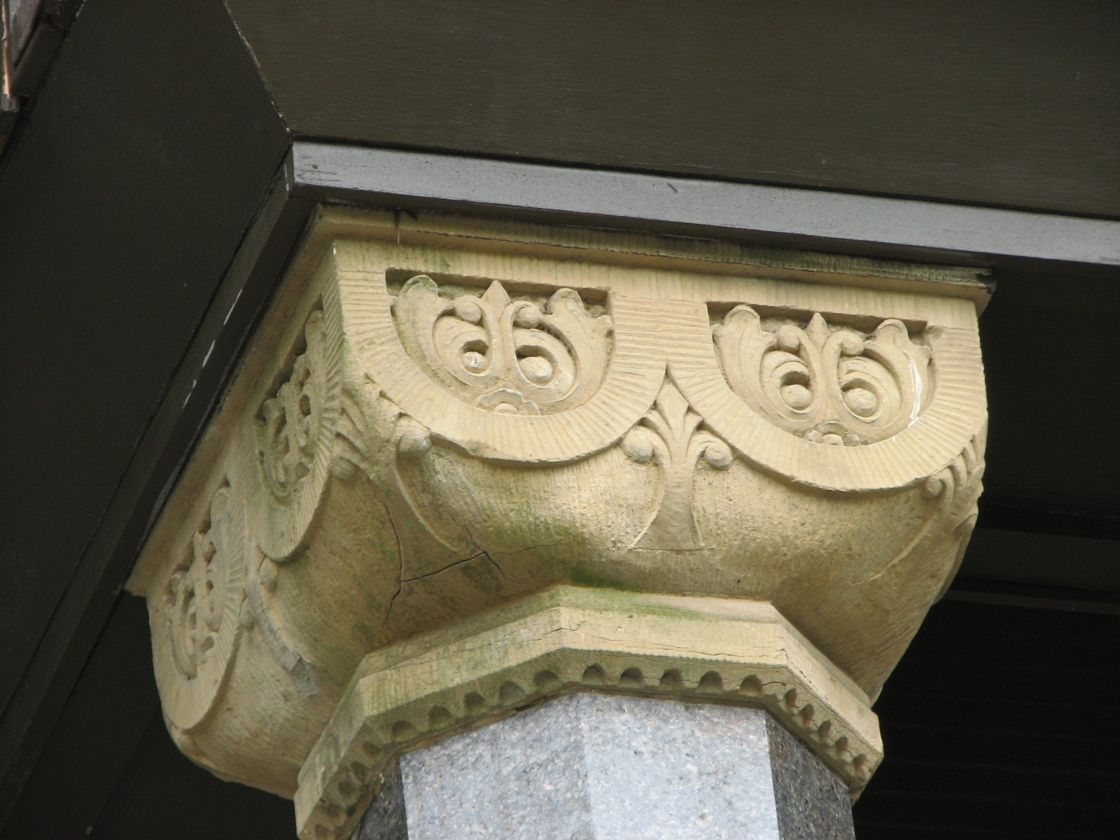 Decorative column capitals distinguish what began as separate houses.
