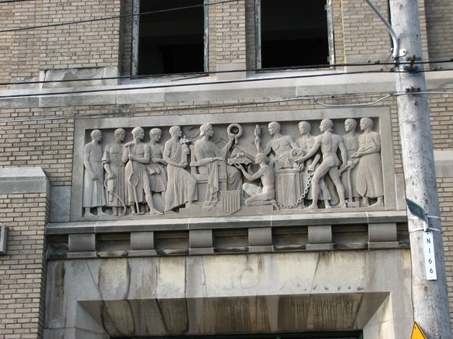 A bas-relief sculpture above the north entrance celebrates the school's vocational mission.