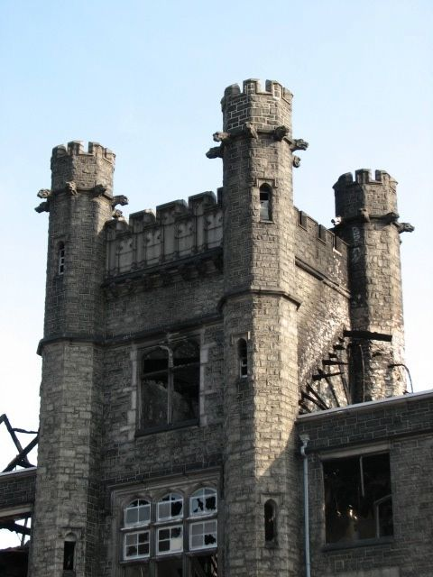 The building's distinctive turret survived more than a century of change.