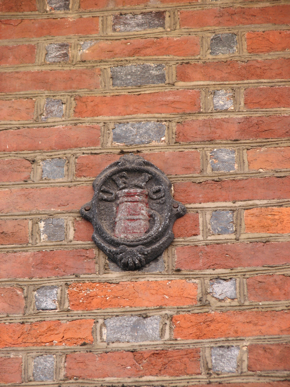 Many of the original fire insurance company plaques can be found on the homes.