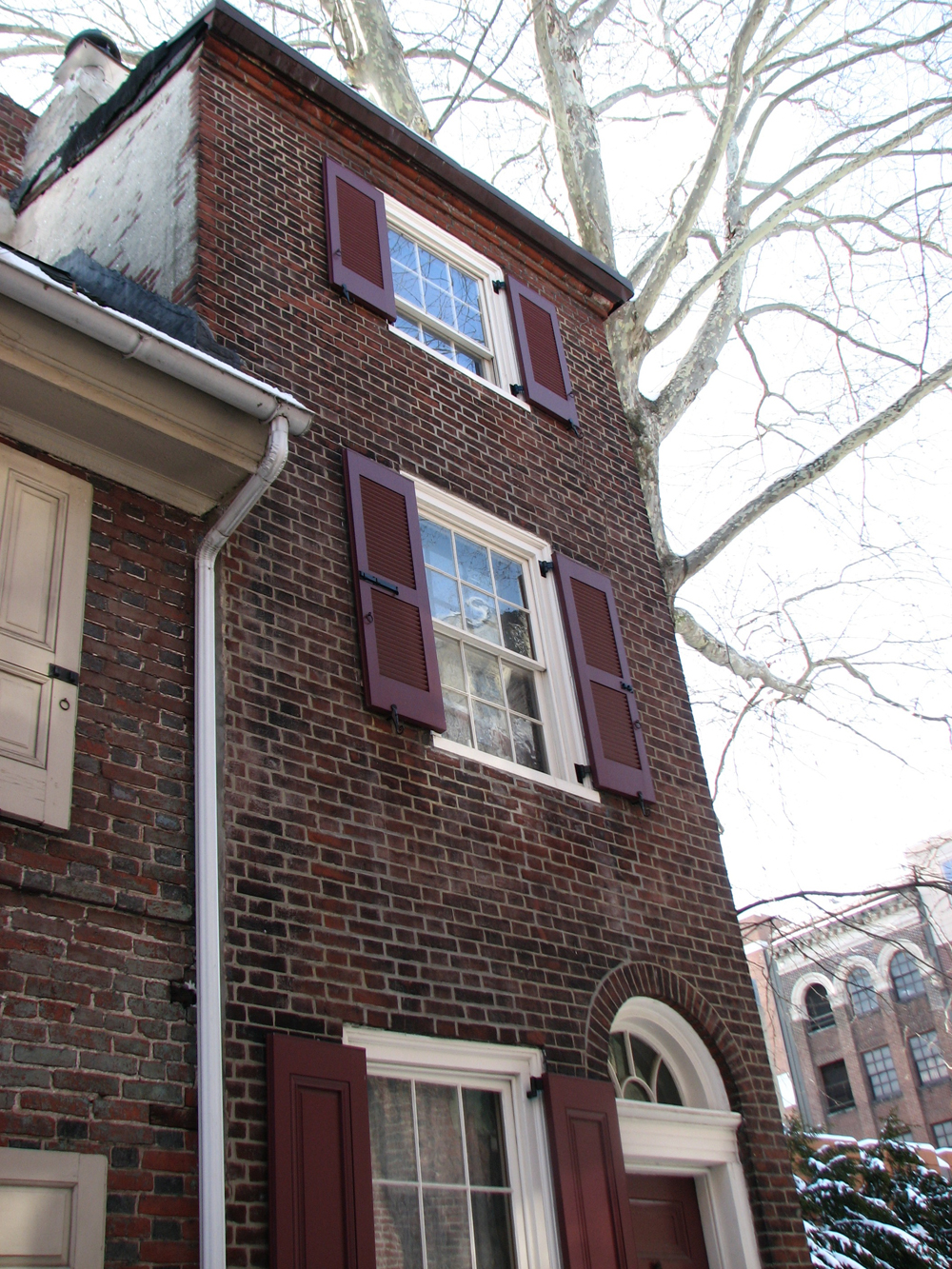 The narrow house at the end of the alley's south side is known as the Half House.