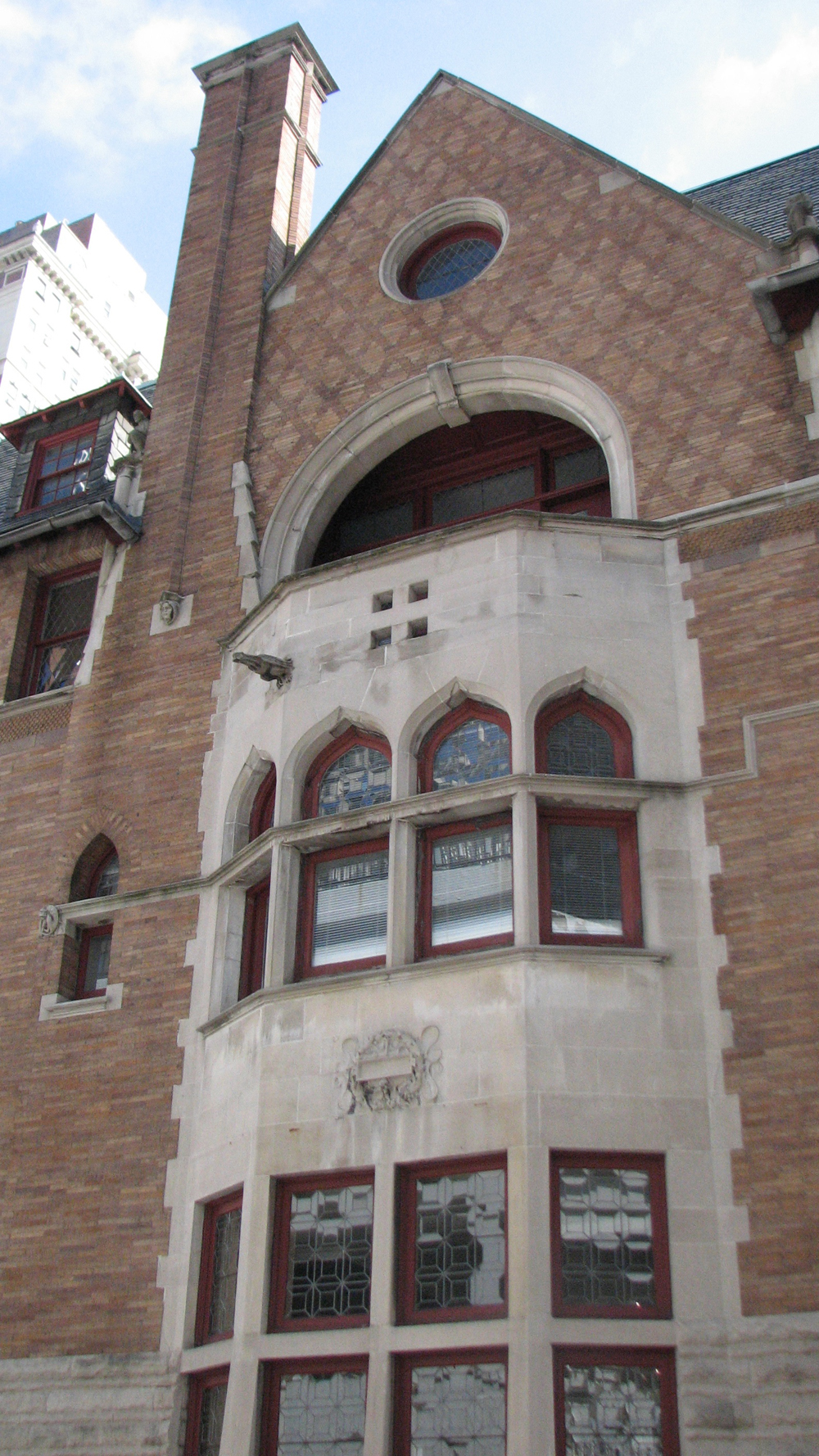 The side of the Moore House features a Venetian-style loggia on the top floor.