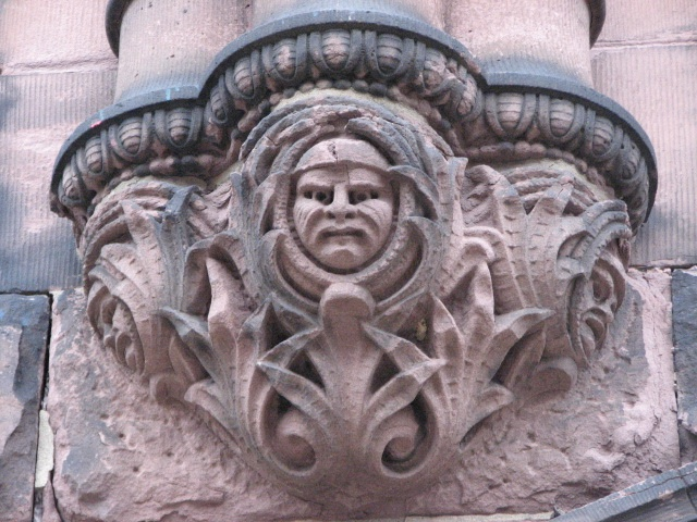 Grimacing and smiling faces adorn the main entrance.