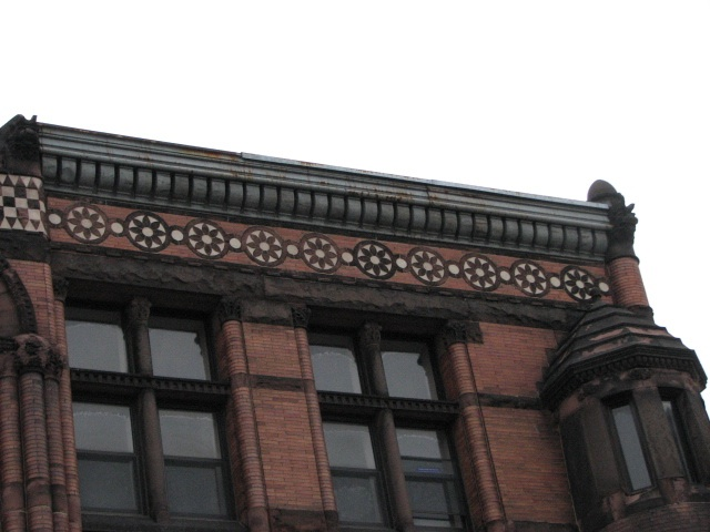 Floral roundels appear again along the roof line.