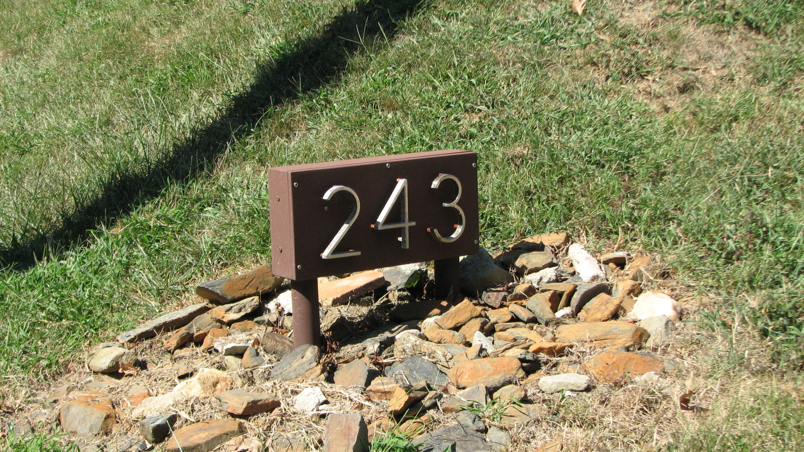 This address sign appears to be an original element of the post-war homes.
