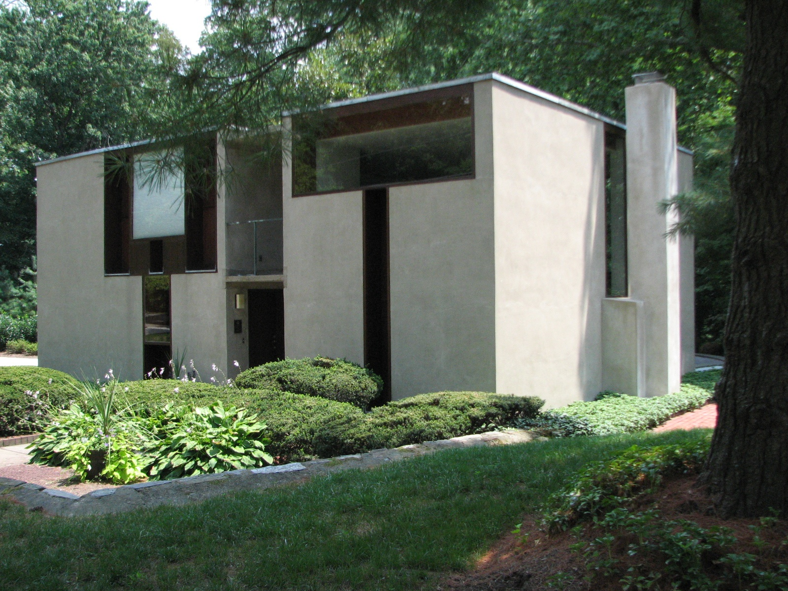 The front of the Margaret Esherick House allows light through two T-shaped windows.