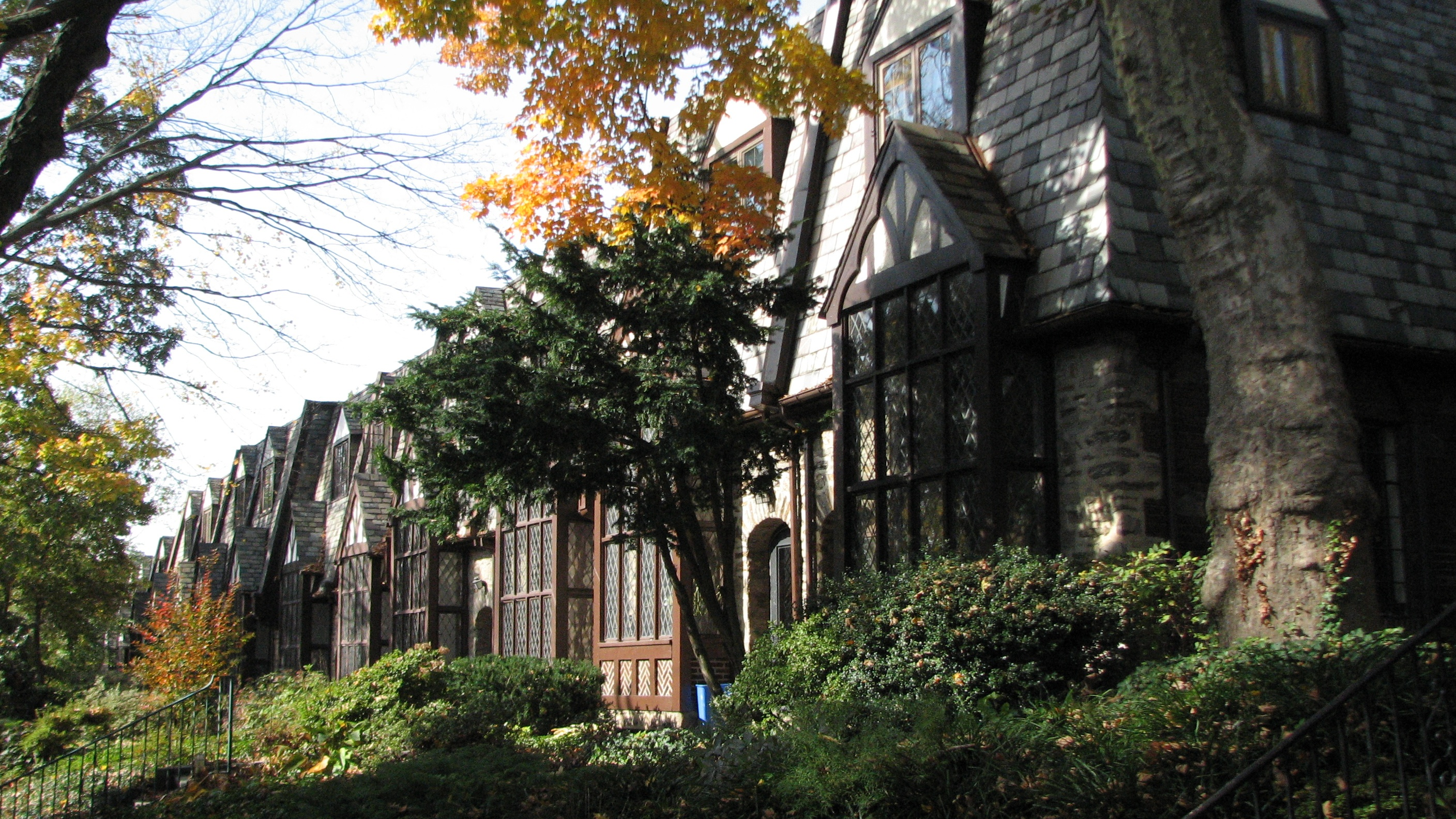 Row houses built in the Tudor Revival style lend East Falls' main thoroughfare its distinctive character.