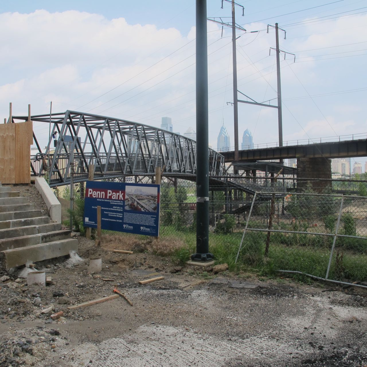 A sign naming the site with Paley Bridge Extension in background