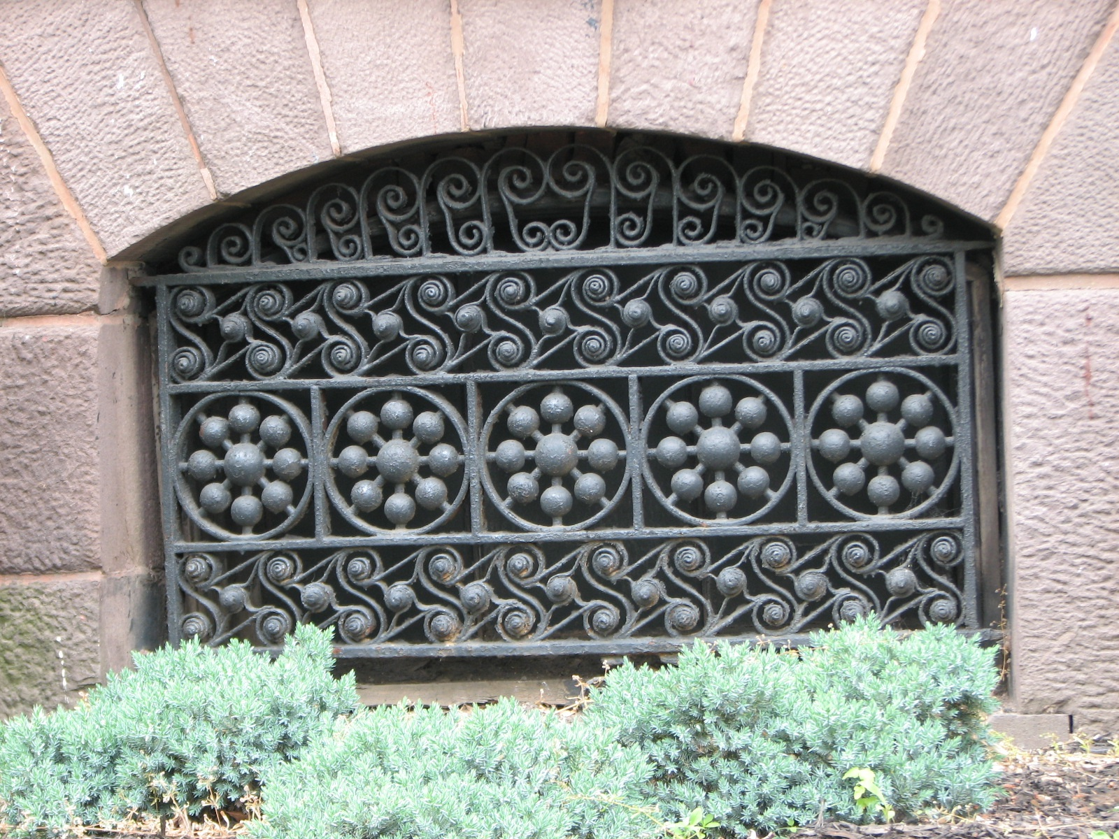 Original ironwork and other details adorn the well-maintained exterior of the house.