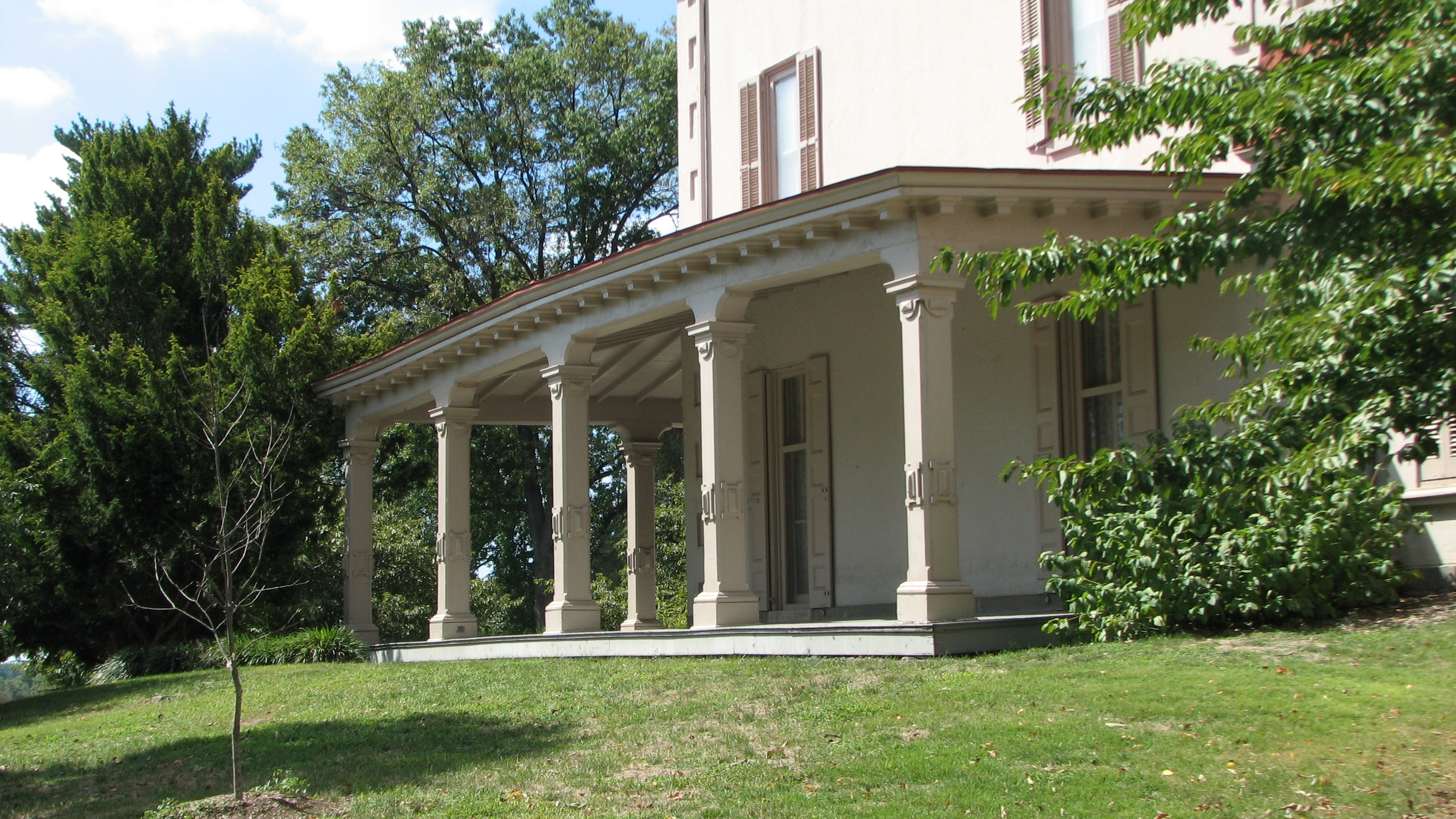 A grand veranda wraps around the Ryerss mansion.